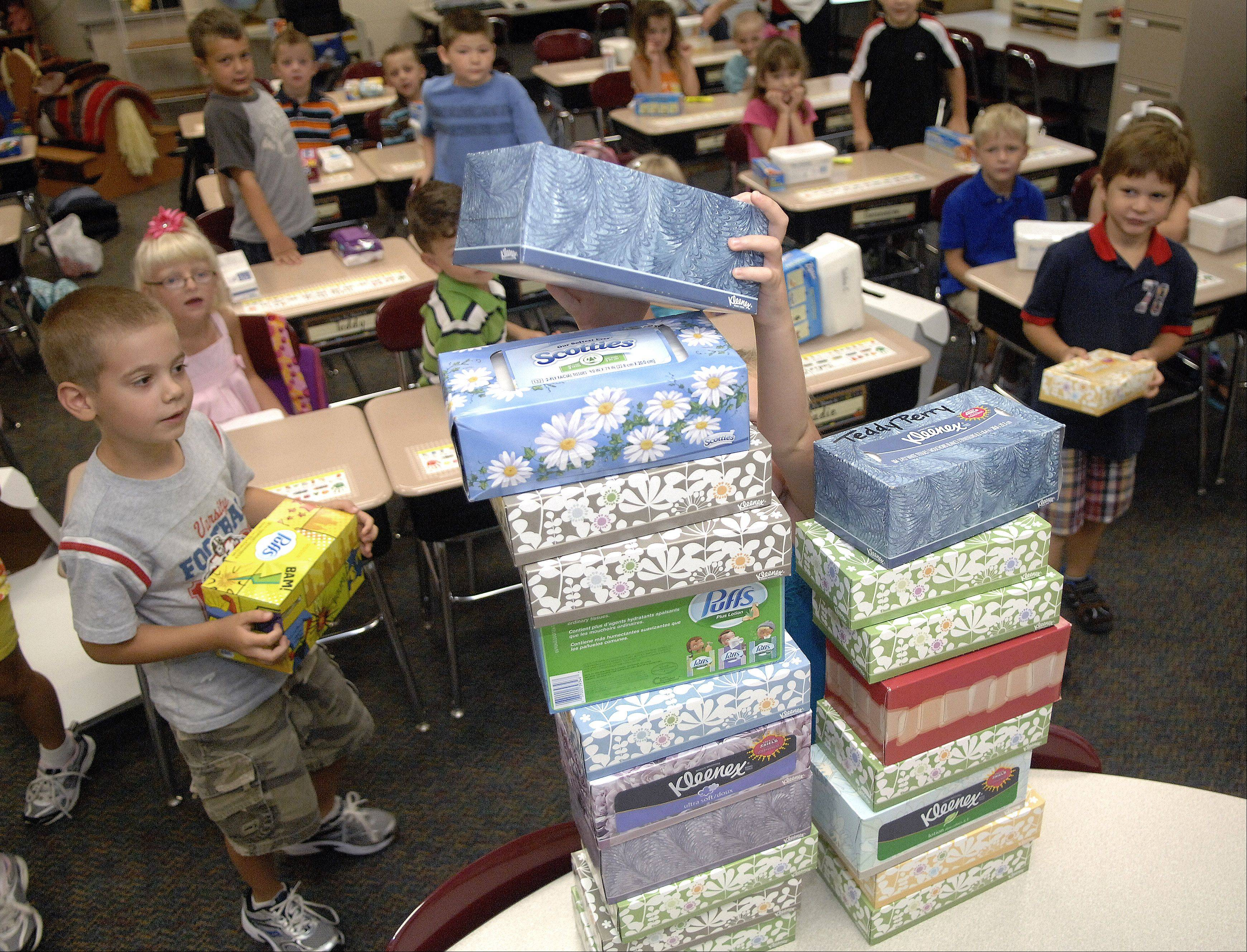 Students in Kim Christensen's first-grade class build a tissue tower with their supplies as a fun activity on their first day of school at Williamsburg Elementary on Wednesday.