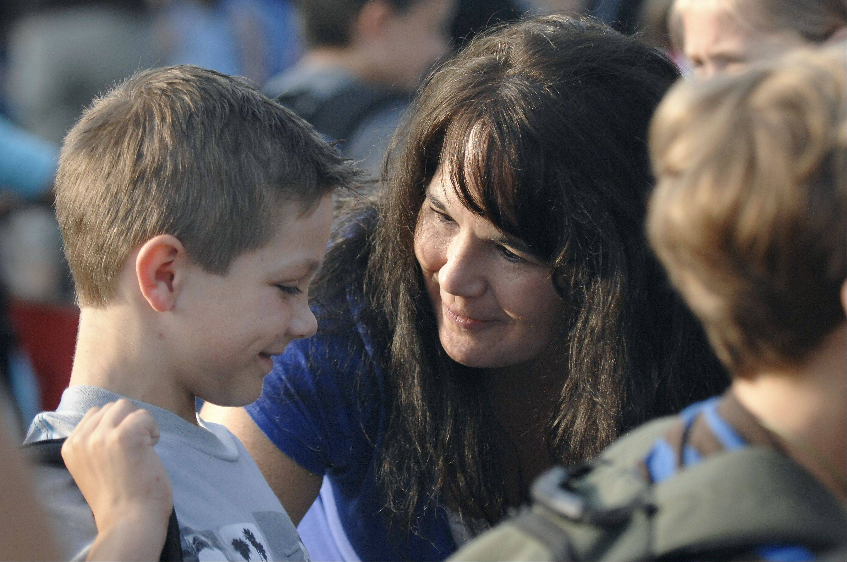 Kim Jacobsen says goodbye to her son, Evan, 9, before he starts his first day of fourth grade at Williamsburg Elementary on Wednesday. Jacobsen said she could tell he was a little bit nervous but also excited as he has several good friends in his class.