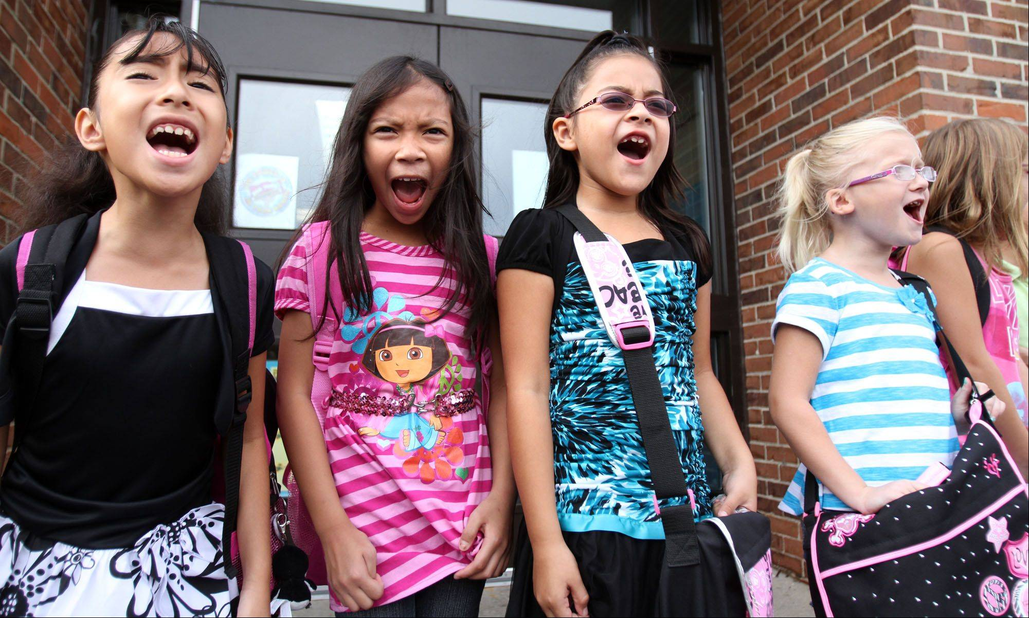 Students at outside of Anne Fox School sing a welcome to school song on the first day of school in Hanover Park which is part of Schaumburg Township Elementary District 54 on Wednesday.