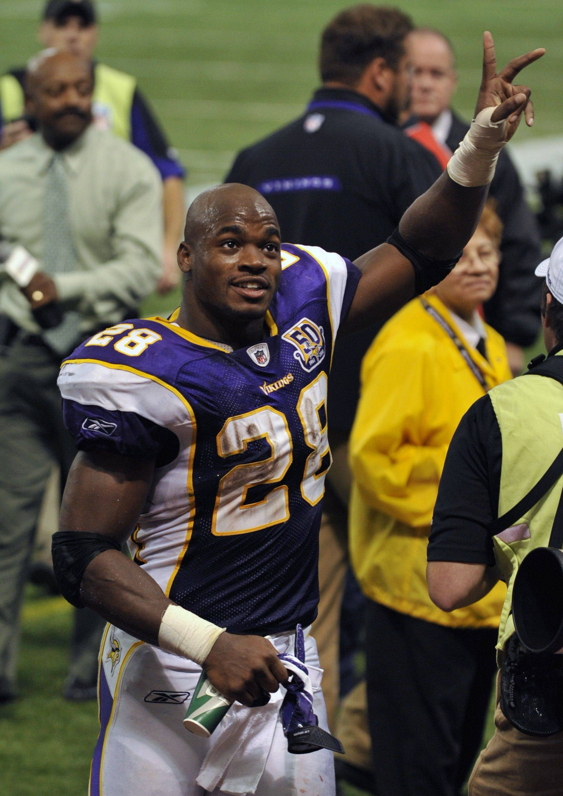Minnesota Vikings running back Adrian Peterson (28) waves to fans after the Vikings defeated the Detroit Lions 24-10 in an NFL football game last season in Minneapolis. Peterson rushed for 160 yards on 23 carries, including a career-long 80-yard touchdown run.