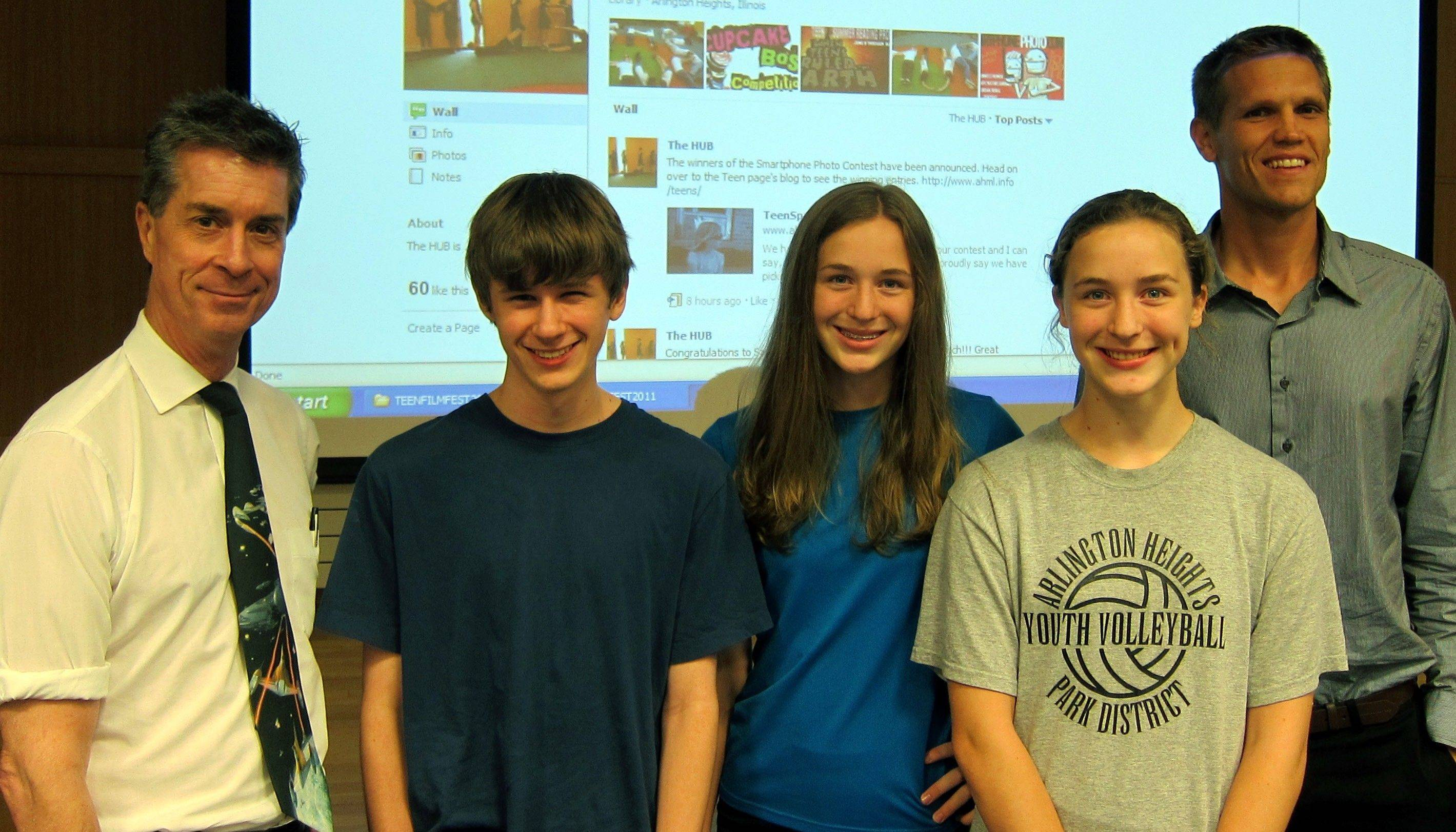 Film critic Dann Gire, left, and teen librarian Tom Spicer, right, flank first-place winner Ross Constable, third-place winner Danaca Fiedler and second-place winner Kyrie Fiedler at the Teen Film Fest at the Arlington Heights Memorial Library.
