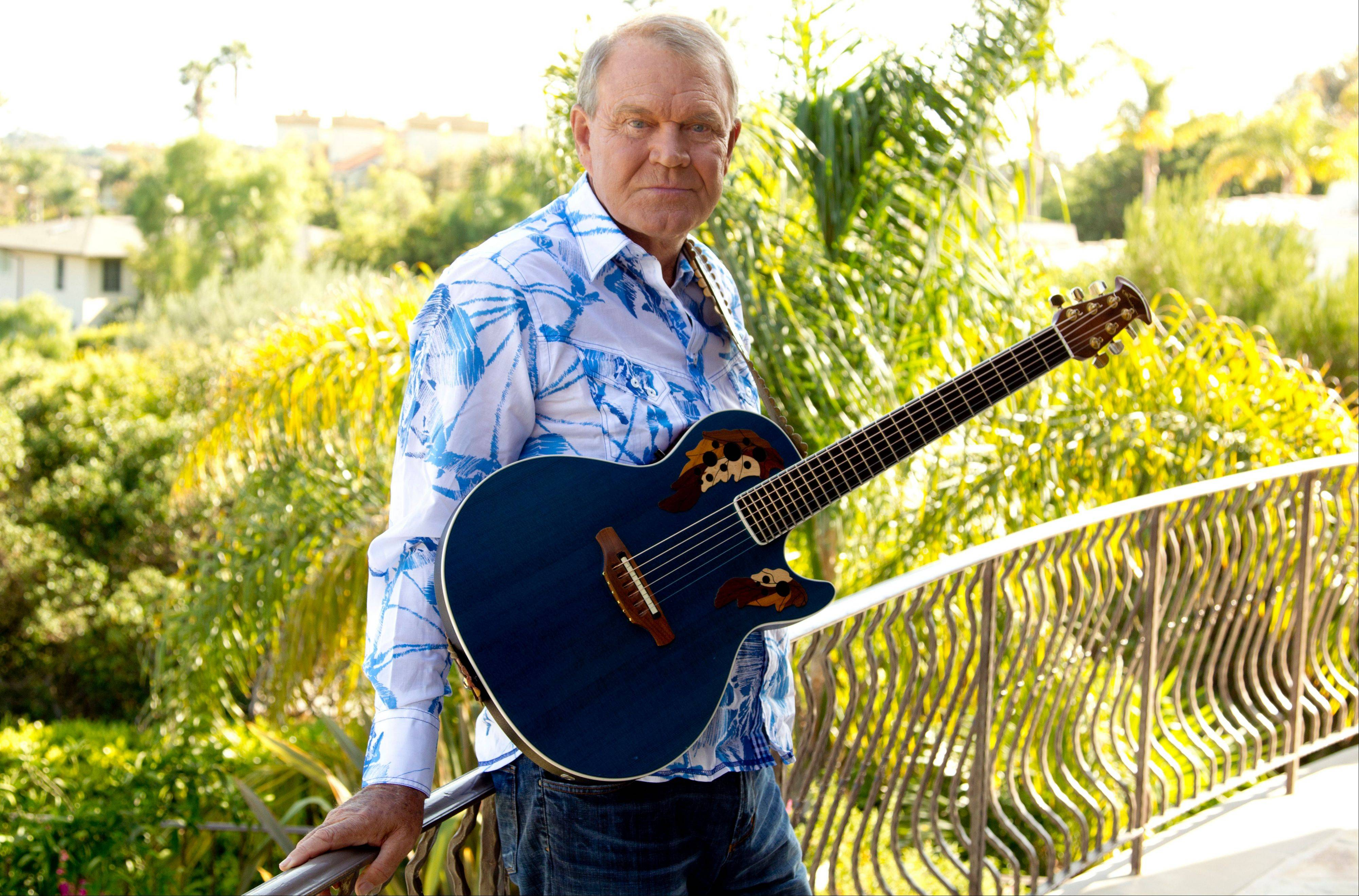 In this July 27, 2011 photo, musician Glen Campbell poses for a portrait in Malibu, Calif. Campbell, who was diagnosed with Alzheimer's disease, is planning a farewell tour before retiring from the music. (AP Photo/Matt Sayles)