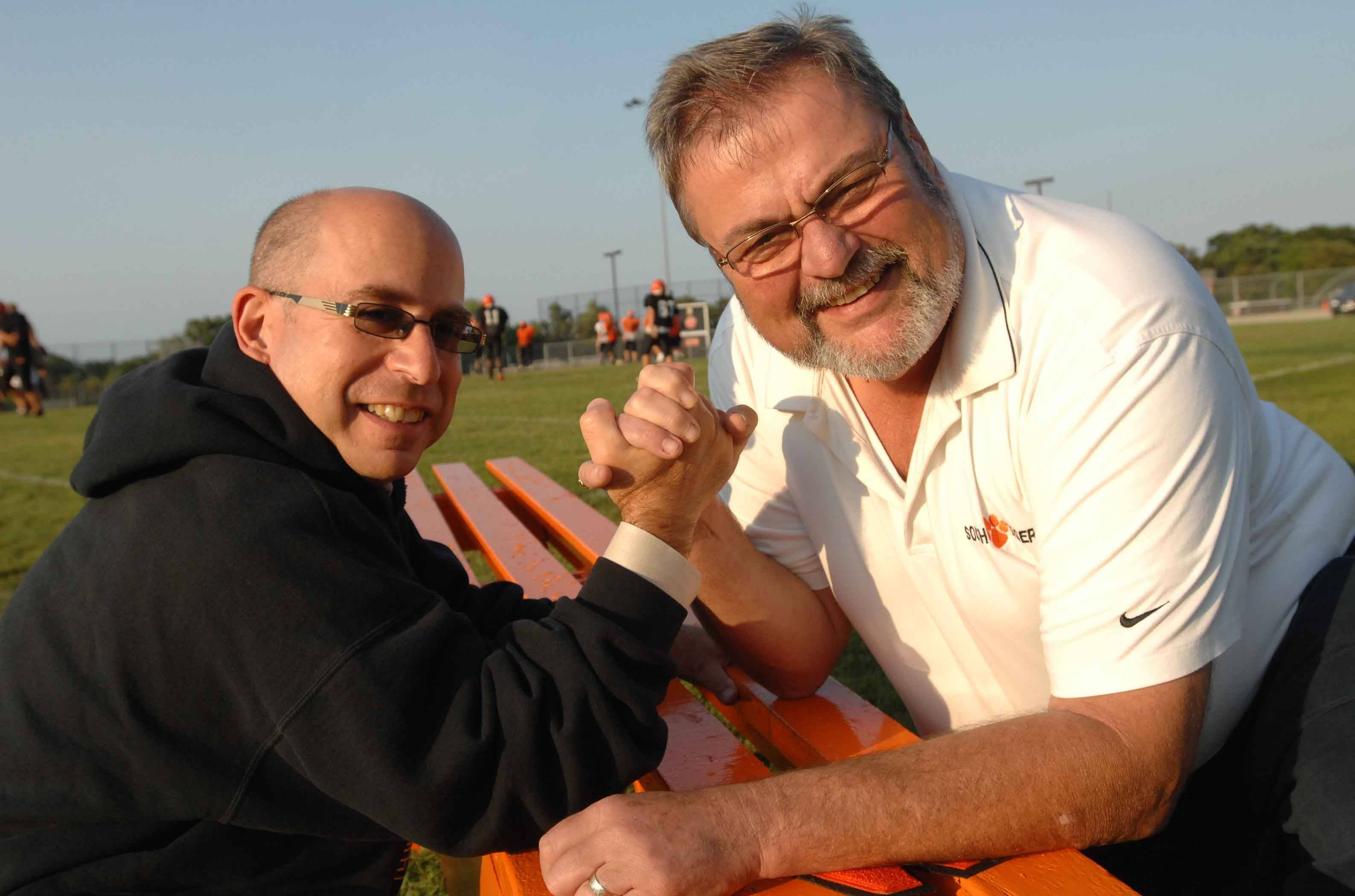 Glen Ellyn Village President Mark Pfefferman, left, and Wheaton Mayor Mike Gresk say Sunday?s nationally televised matchup between Glenbard West and Wheaton Warrenville South high schools is a ?friendly rivalry,? one that prompted them to lay civic pride on the line in a wager on the game.