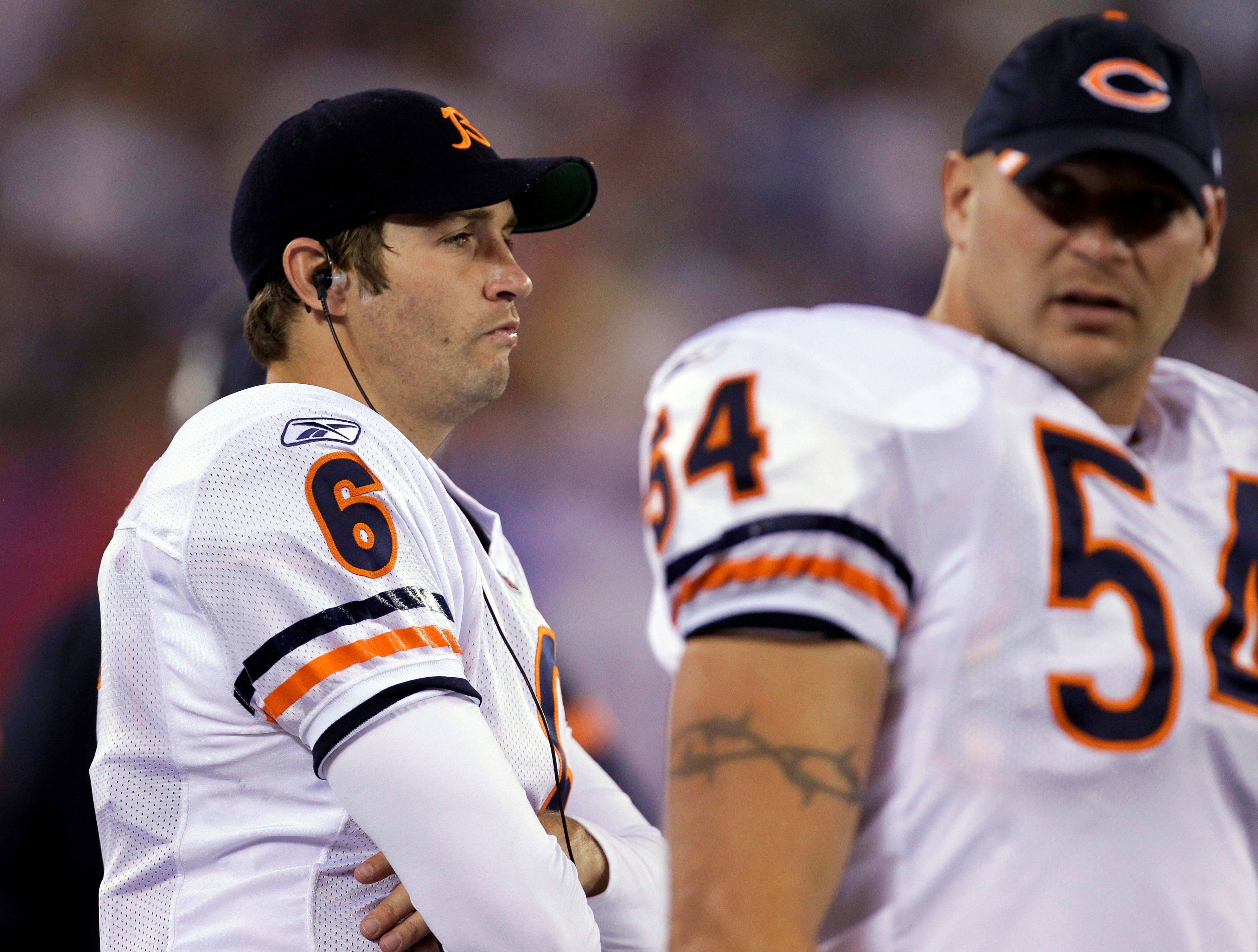 Jay Cutler and teammate Brian Urlacher stand on the sideline during the Bears' preseason game against the Giants. Cutler understands Mike Martz's offense much better this year and has no problems telling teammates when they do something wrong.