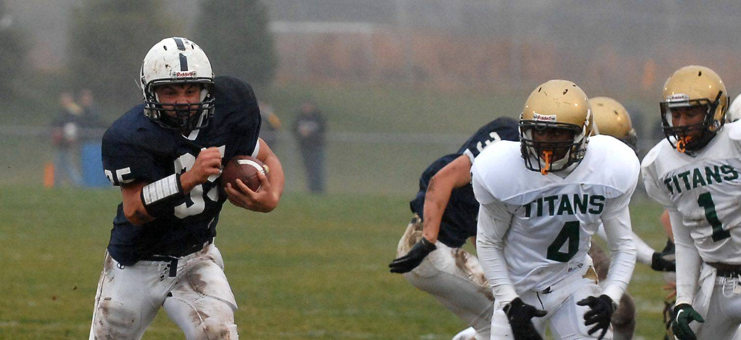 Cary-Grove's Patrick O'Malley runs against Rockford Boylan during a 2010 playoff game in Cary. The Trojans open the season under new coach Brad Seaburg tonight at St. Charles East.