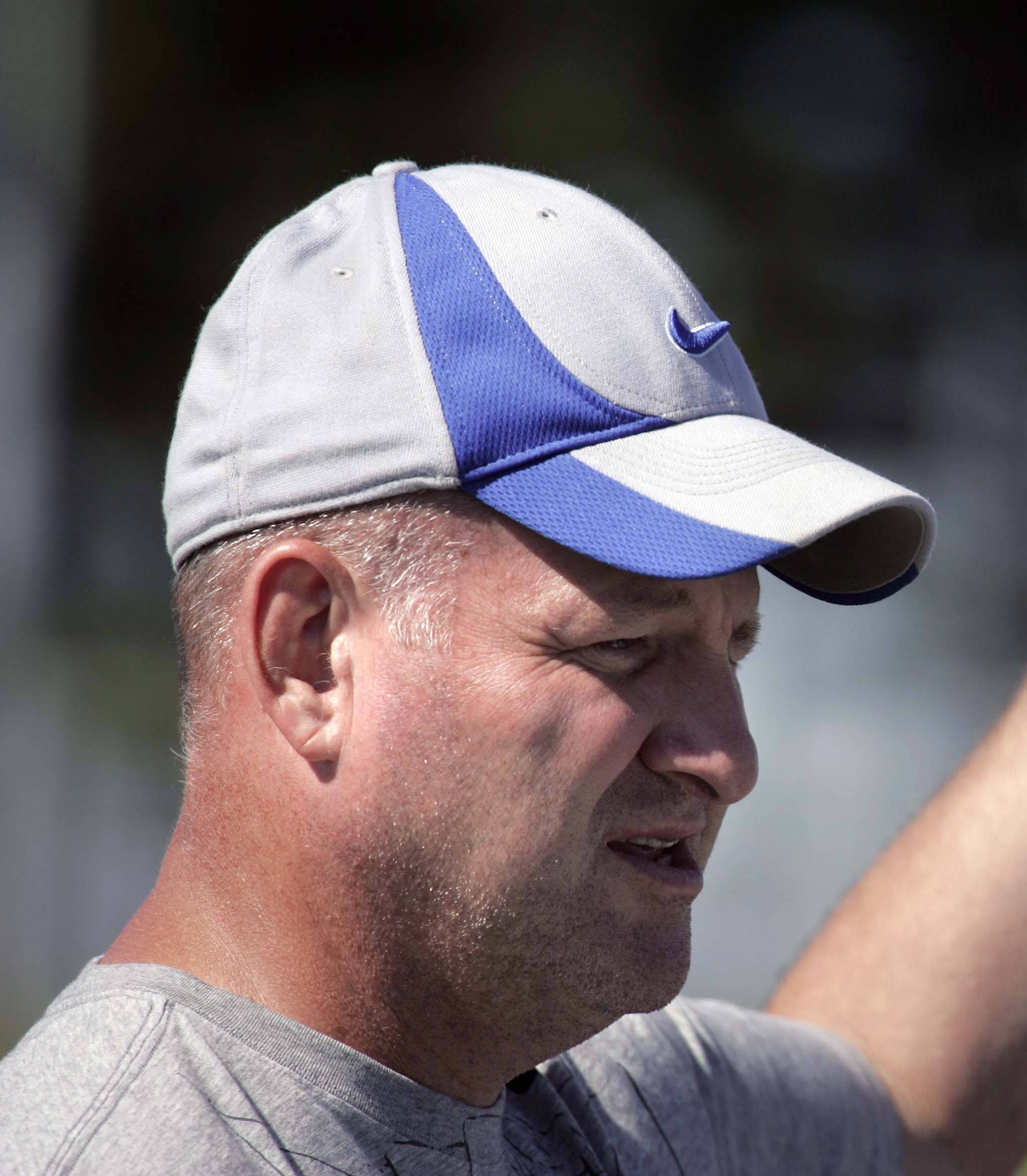 New head coach Rich Crabel talks to his players during the first day of Burlington Central football practice. The Rockets open the season tonight at Hampshire.