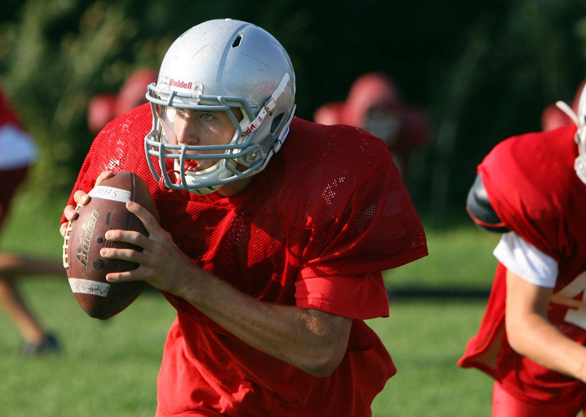 Quarterback Gable Leppert runs the offense during practice at Mundelein High School this week.