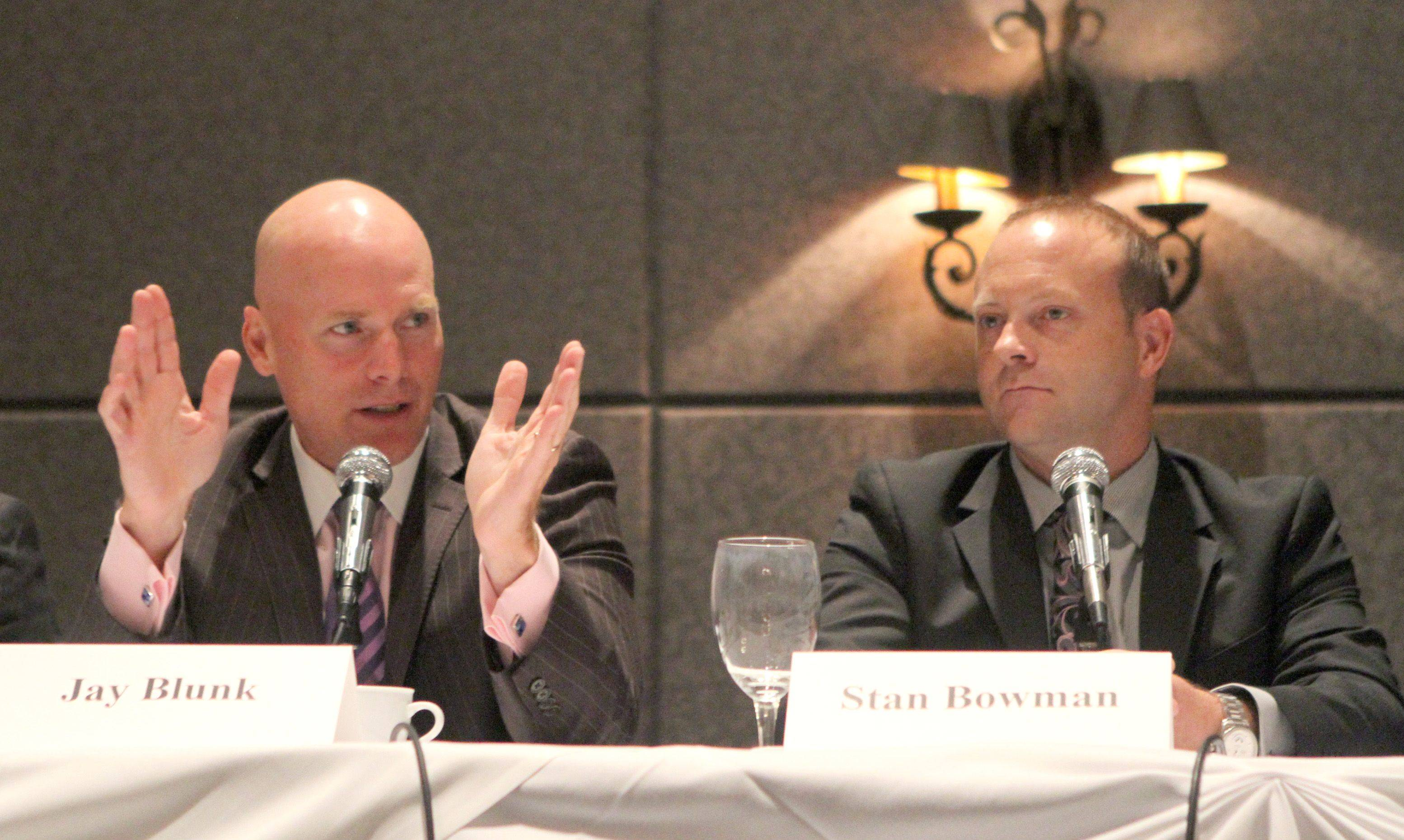 Jay Blunk, executive vice president of the Chicago Blackhawks, and Stan Bowman, vice president/general manager of the Chicago Blackhawks, answer questions at the Daily Herald Business Ledger Newsmakers Forum Thursday in Hoffman Estates.