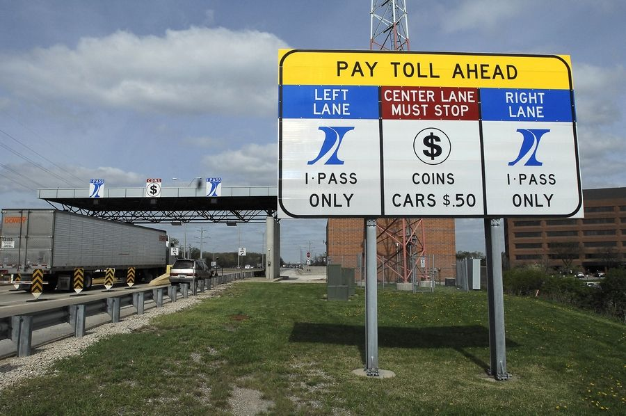 The Illinois tollway board voted Thursday to nearly double tolls on Jan. 1 to pay for an ambitious construction plan.