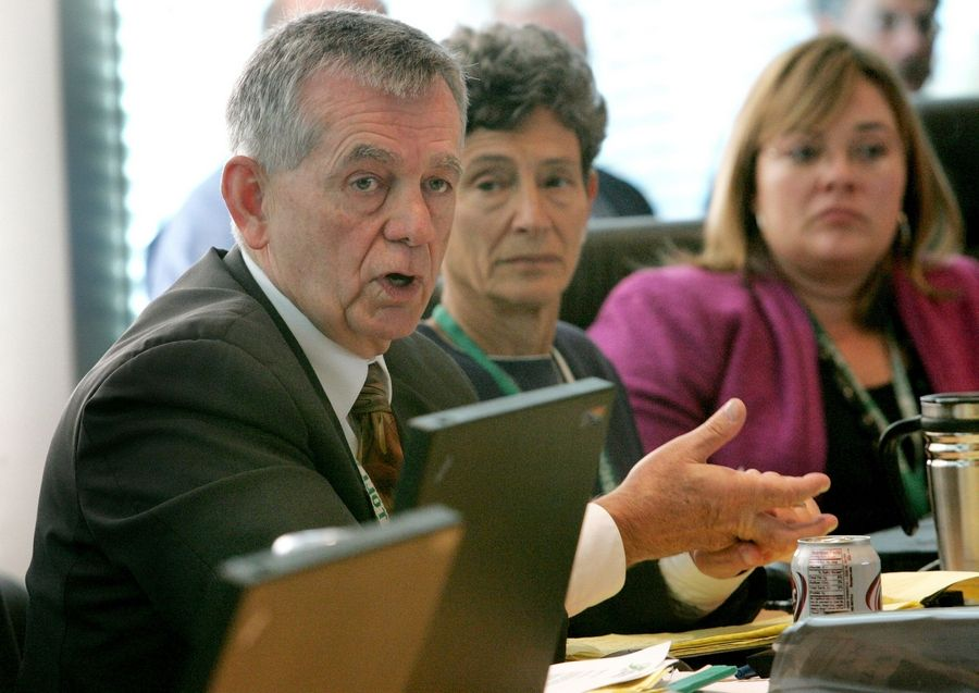 Director Bill Morris makes a point as board chair Paula Wolff, center, and Kristi Lafleur, executive director, right, listen before the Illinois Toll Highway Authority board approved a rate increase Thursday.