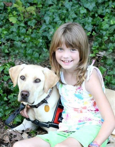 This is Rebecca and her service dog Duke. Rebecca is diabetic and in third grade. She and Duke have been together for about 1� years, and Duke warns her when her blood sugar level is too high or too low.