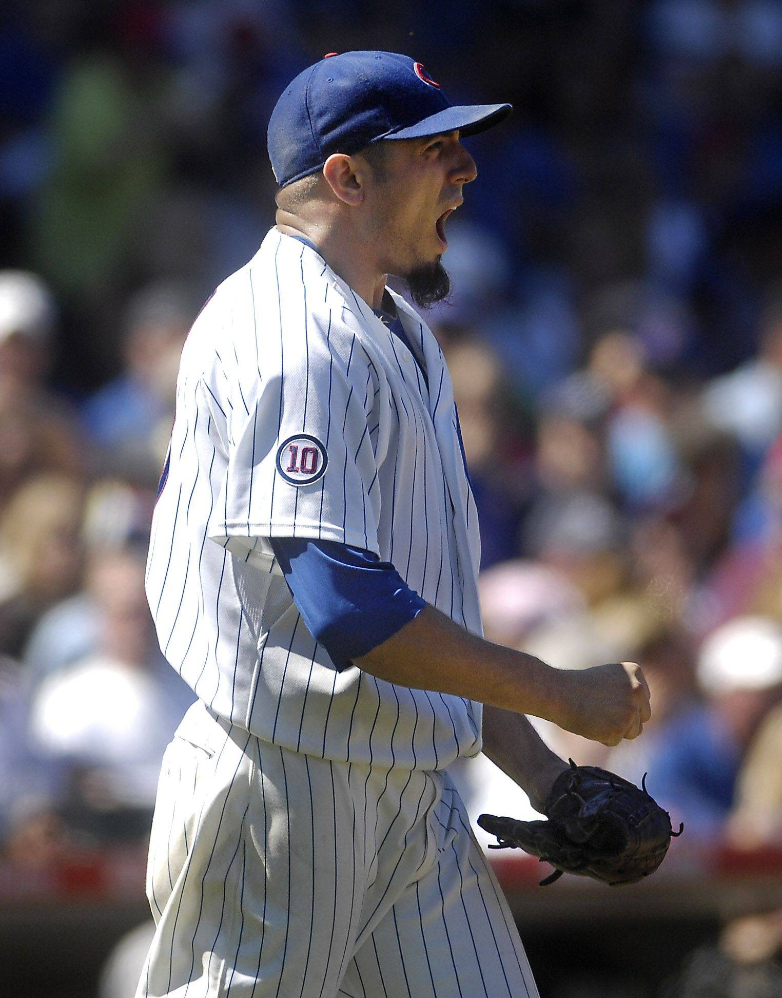 Chicago Cubs starting pitcher Matt Garza lets out a scream after walking in a run with the bases loaded in the third inning.