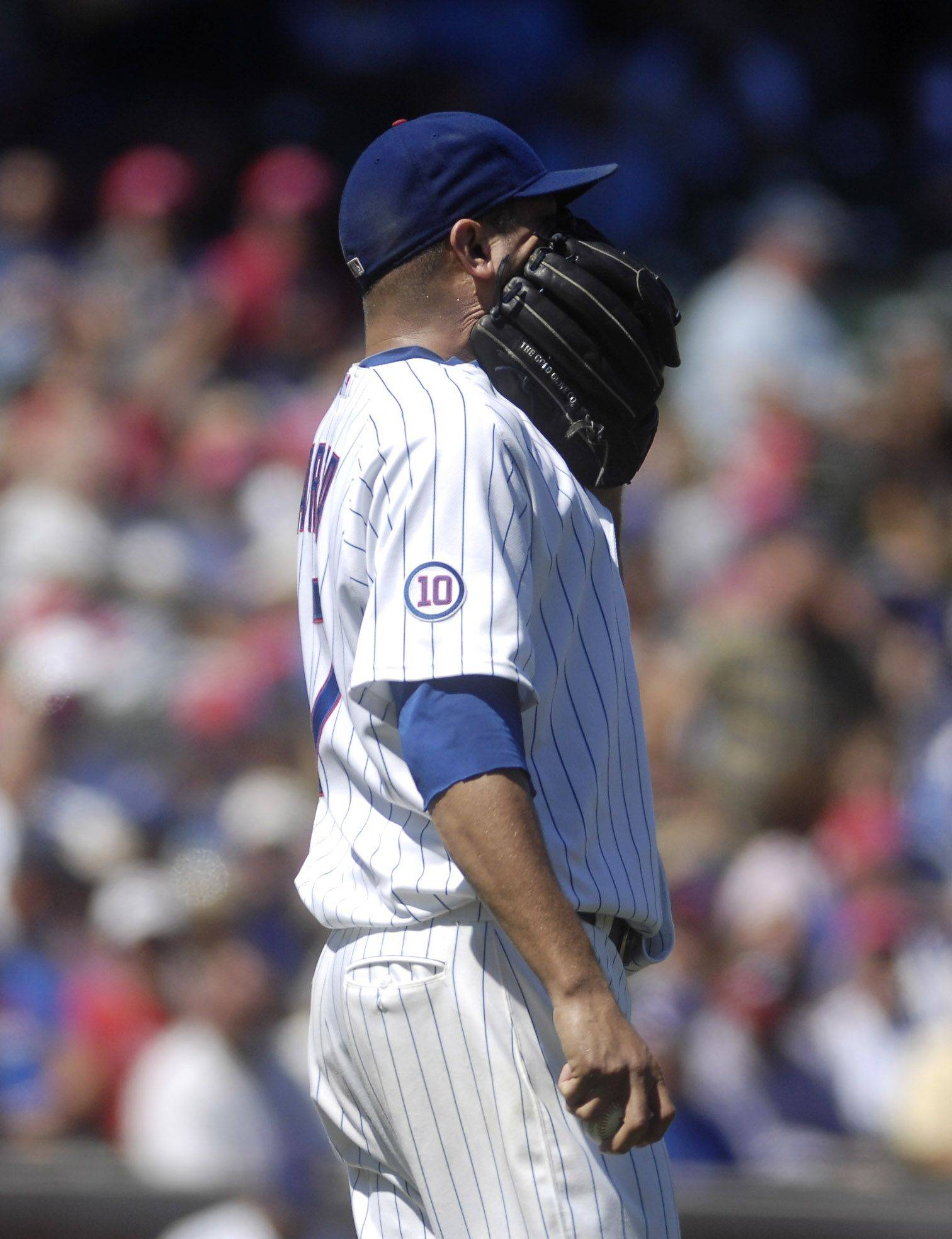 Chicago Cubs starting pitcher Matt Garza reacts after giving up a three-run homer in the first inning to Brian McCann.