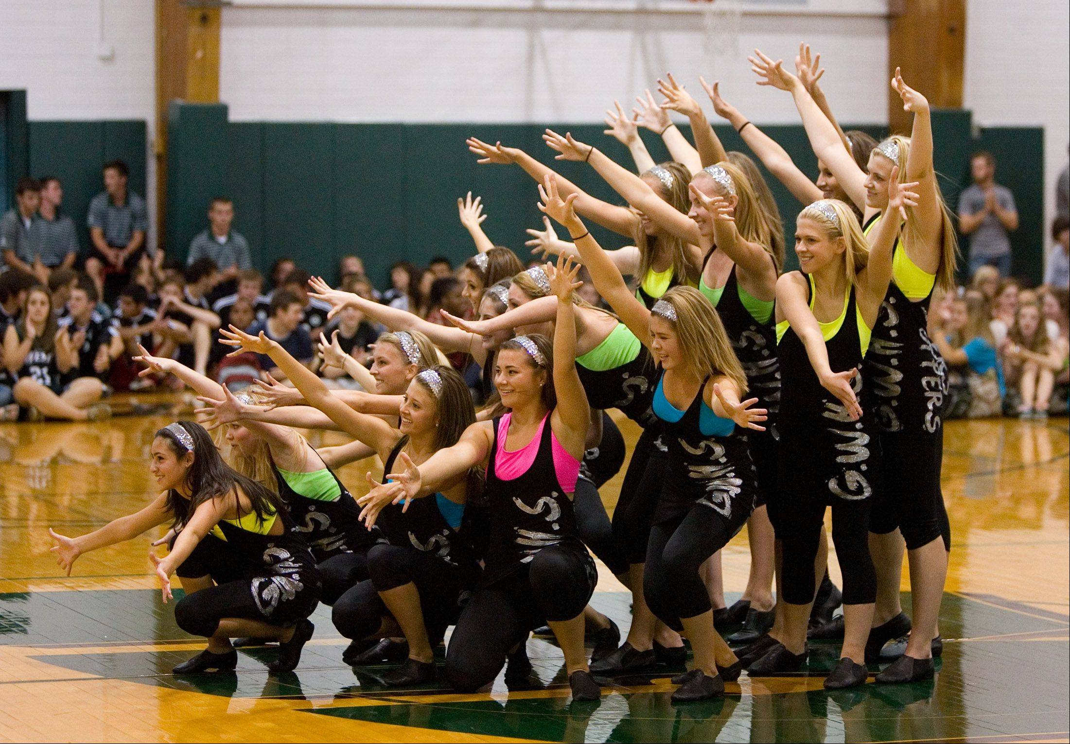The Glenbard West dance squad finishes its routine during Friday's pep rally.