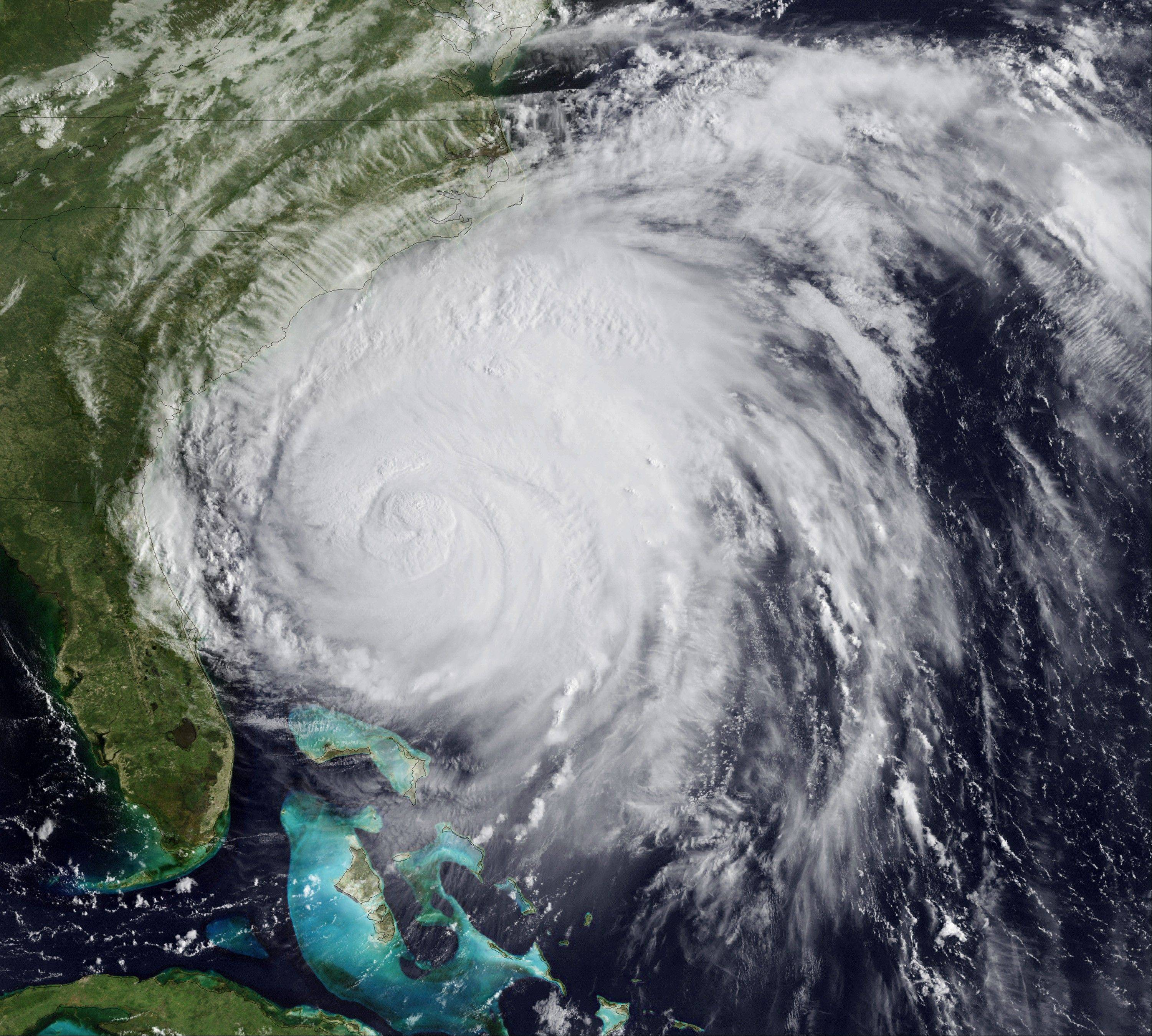 This satellite image provided by NOAA and taken at 12:45 GMT Friday Aug. 26, 2011 shows Hurricane Irene as it moves northward along the U.S. eastern coastline with 110 mph sustained winds. Hurricane Irene began lashing the East Coast with rain Friday ahead of a weekend of violent weather that was almost certain to heap punishment on a vast stretch of shoreline from the Carolinas to Massachusetts.