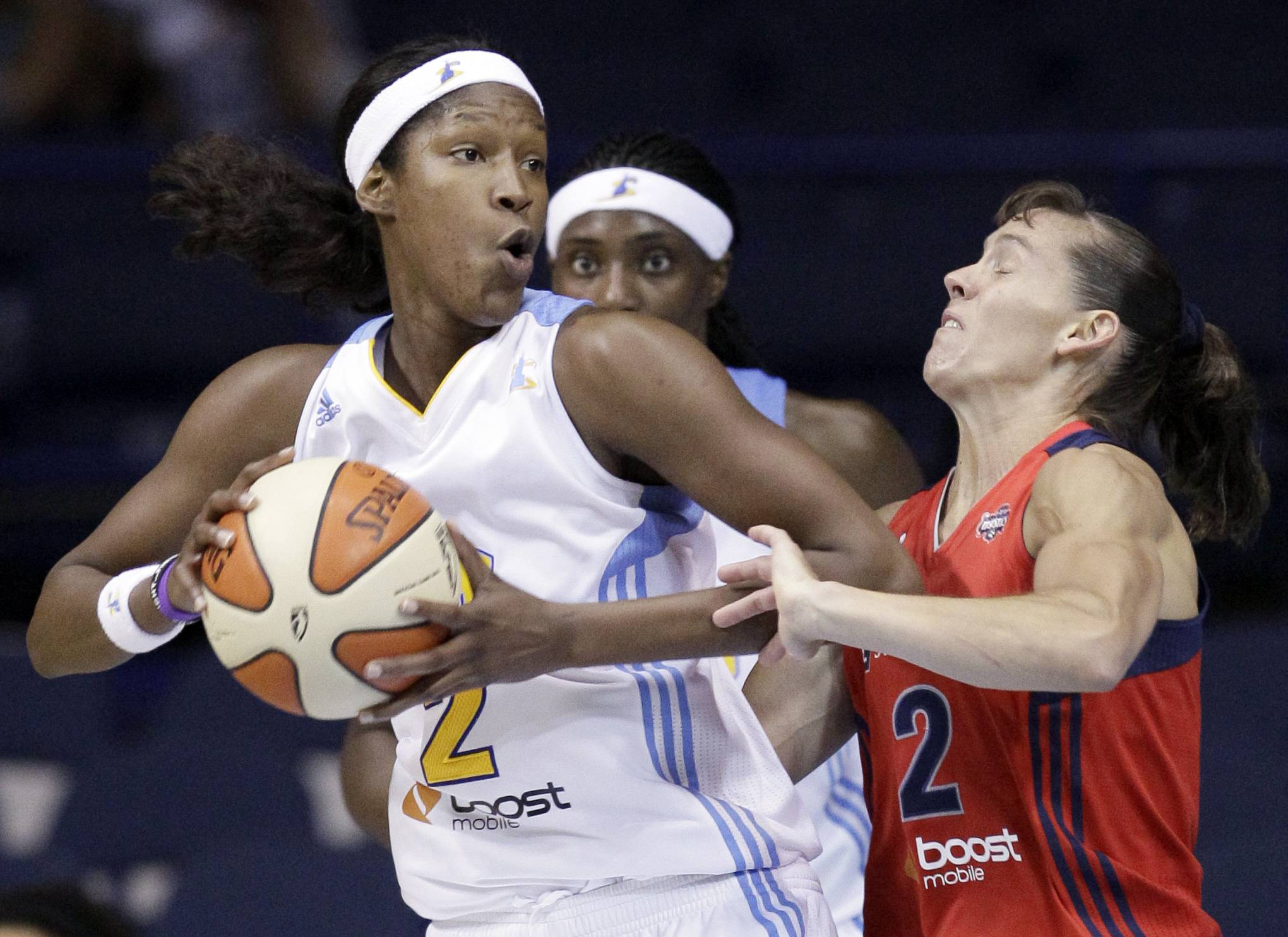 Michelle Snow, left, rebounds the ball against Washington Mystics' Kelly Miller during the fourth quarter Friday night at Allstate Arena.
