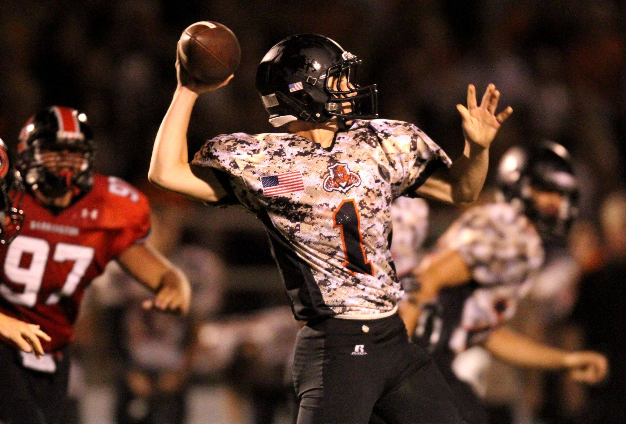 Libertyville quarterback Hutch Herchenback passes against Barrington .
