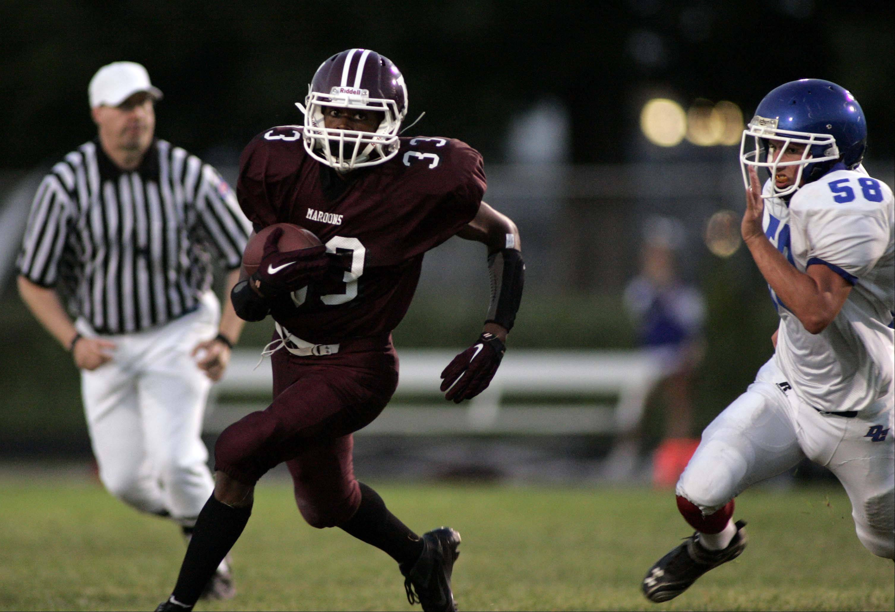 Elgin running back DeVante King makes his way around the end for a first-quarter touchdown against Dundee-Crown.
