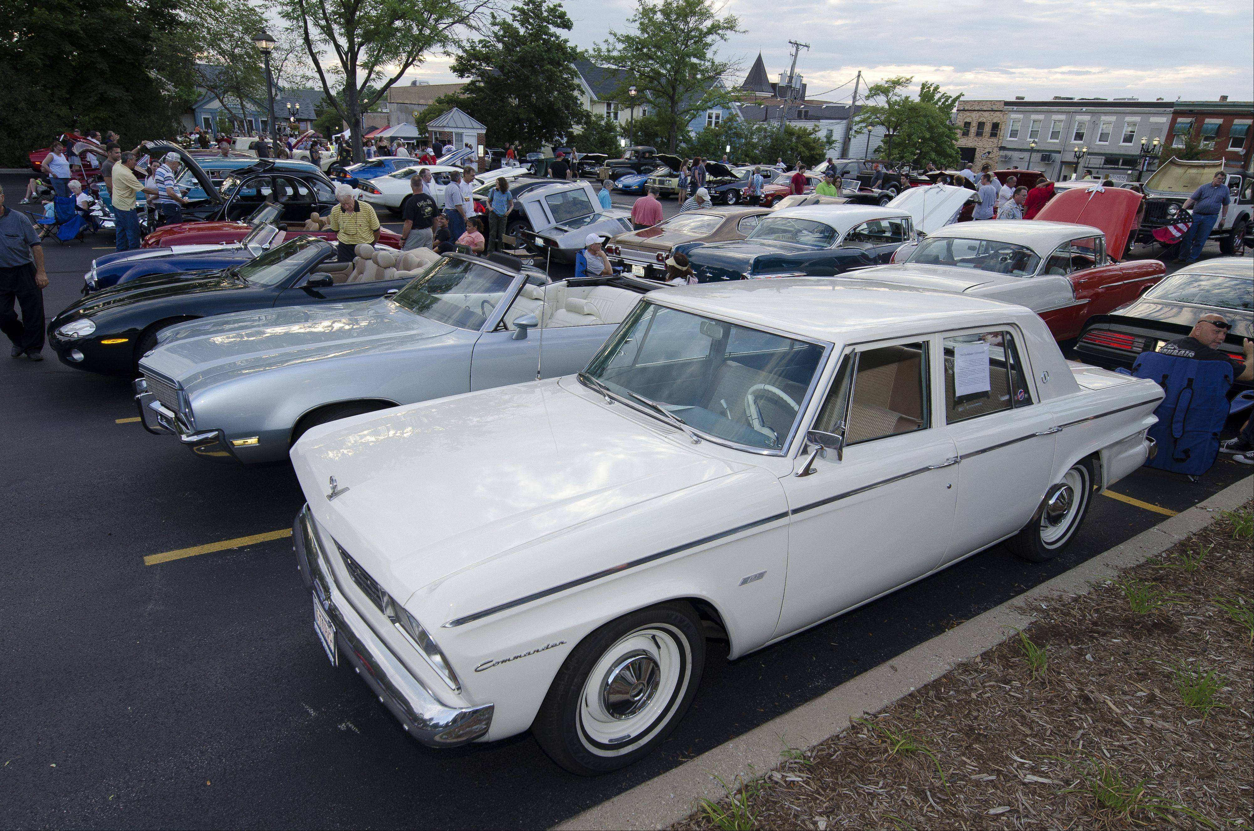 Classics fill a bank parking lot in downtown Barrington during a recent Thursday cruise night.