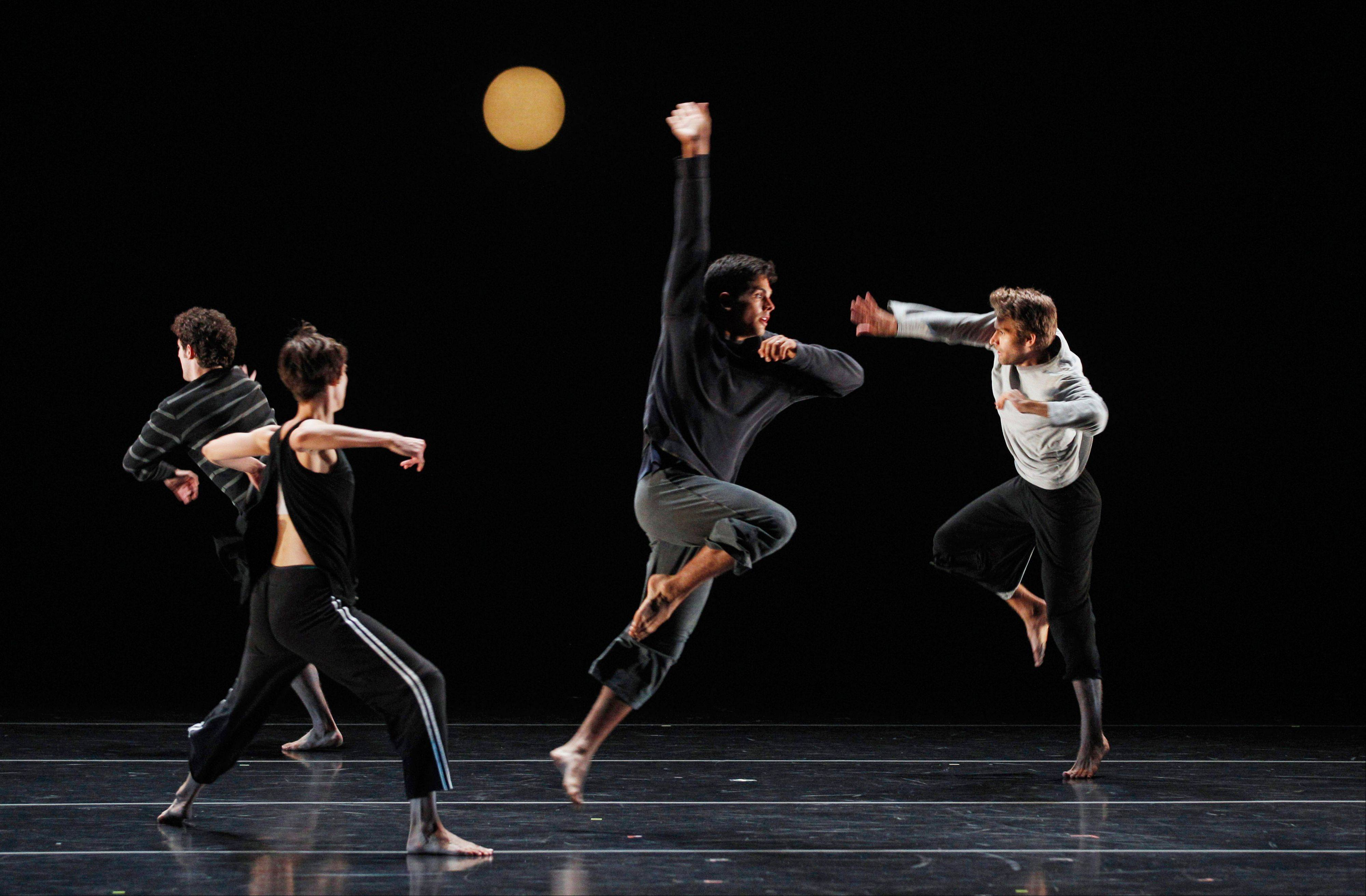 "Alex Springer, center, dances with fellow artists of Doug Varone and Dancers in ""Lux"" during a dress rehearsal for the Chicago Dancing Festival, which ends Saturday, Aug. 27, in Chicago. Chicago Mayor Rahm Emanuel, a former dancer, said his city has everything it needs to become a dance center."