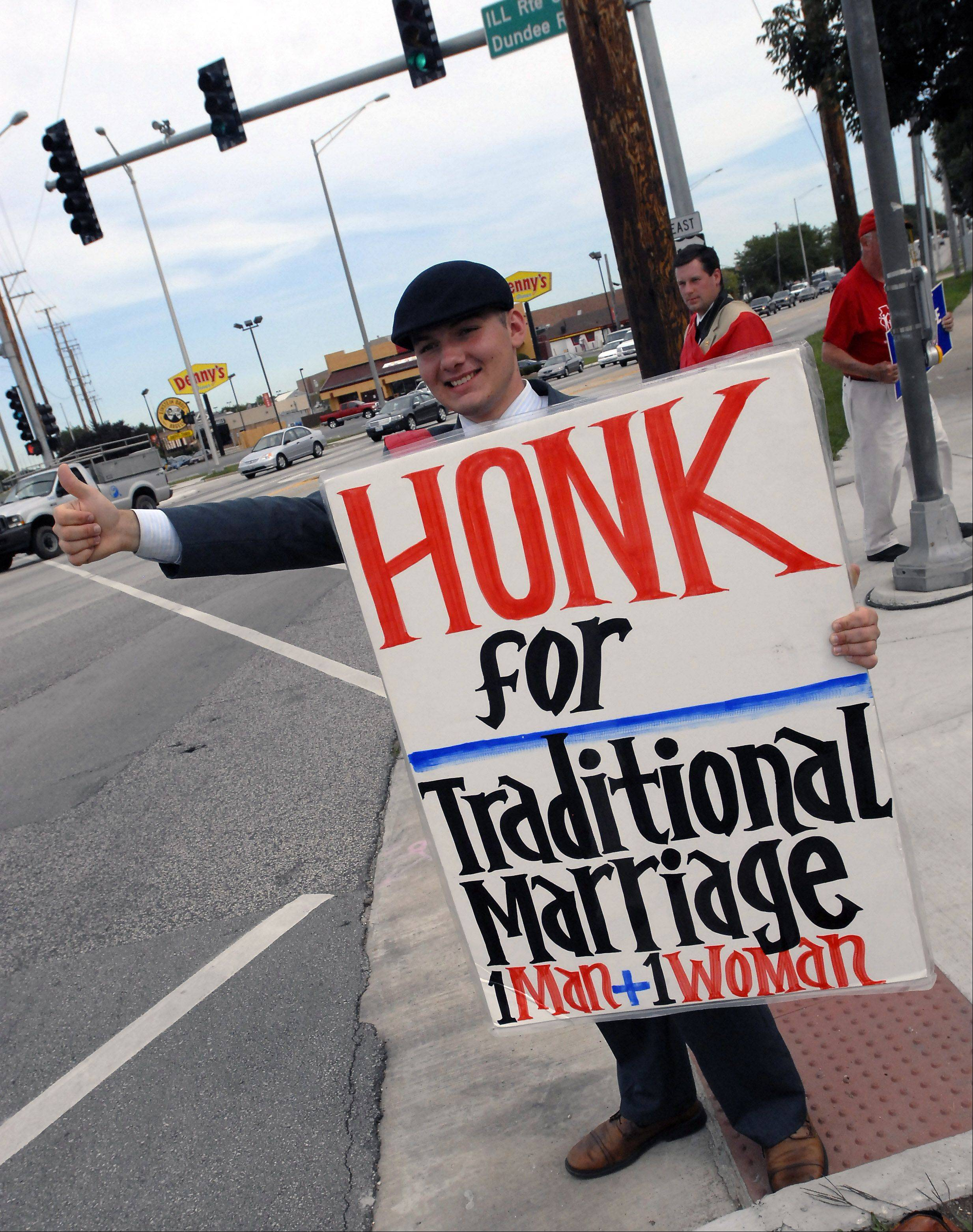 William Stover, a member of the American Society for the Defense of Tradition, Family, and Property, and a resident of Gettysburg, Pa., protests against gay marriage Friday at the intersection of Rand and Dundee roads in Palatine. The group has about 700 members throughout the nation and across college campuses.