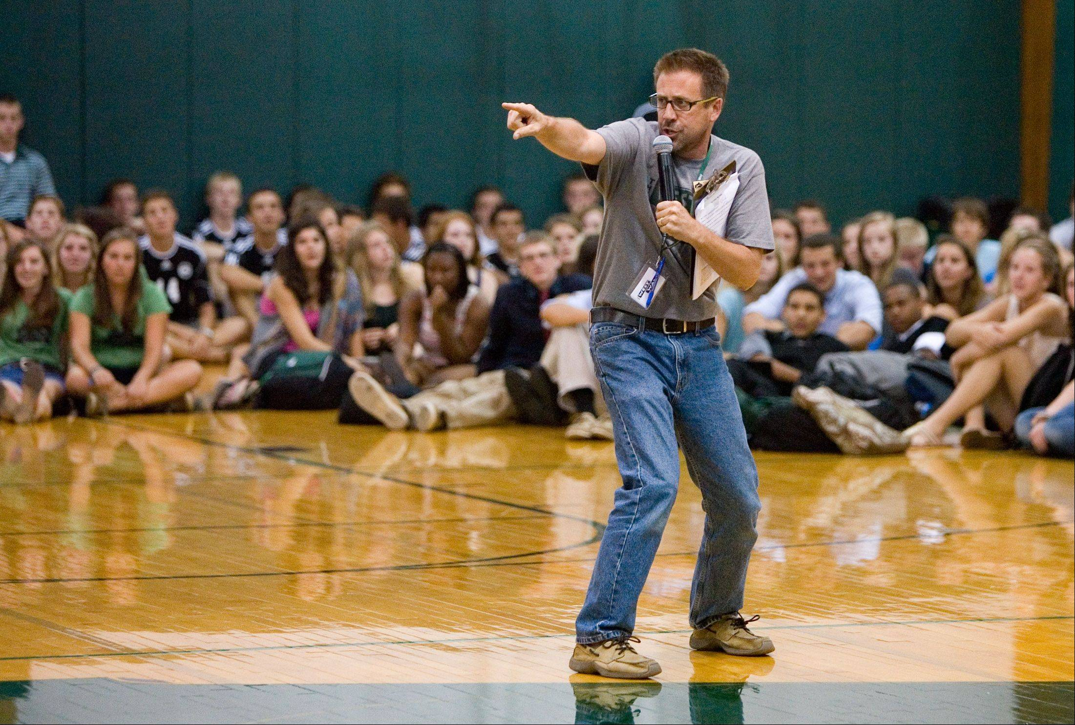 Glenbard West English teacher Steve Wiersum served as emcee for the school's pep rally Friday.