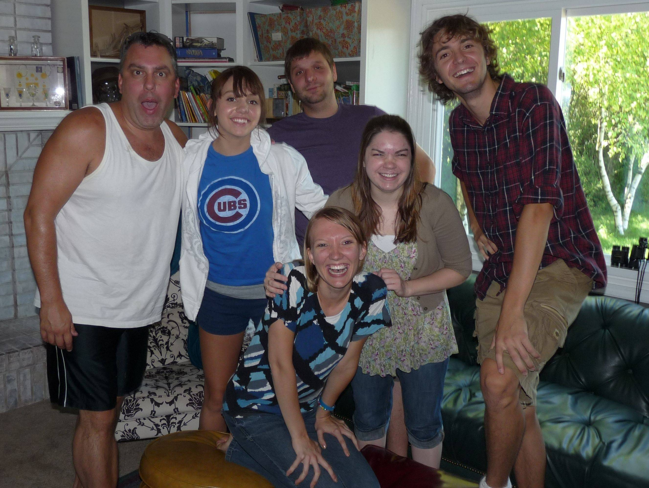 "The cast of ""Inhabit, Scenes in a Warehouse"" pauses for a group photo during rehearsal at the home of director Kellee Stall. From left, in back, are Marty McGinley, Rachel McGinley, Tim Rack, Amanda Spenner and Zachery Draper; in front is Jenny Olson."