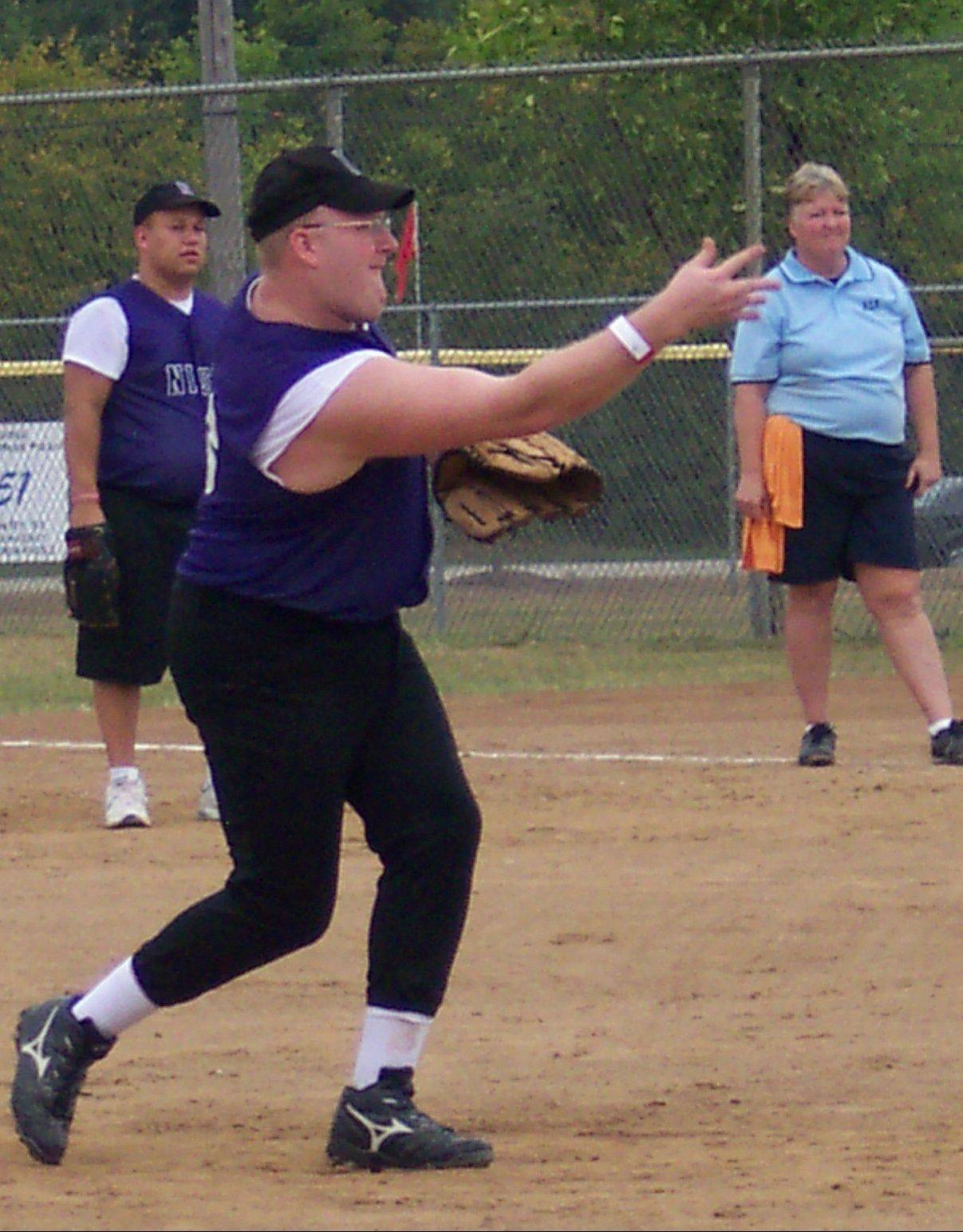 NISRA softball player James Williams practices, with fellow player Rob Michalik in the back ground. The two will participate in the Special Olympics National Invitational Softball Tournament this weekend Aug. 27-28 in Elgin.