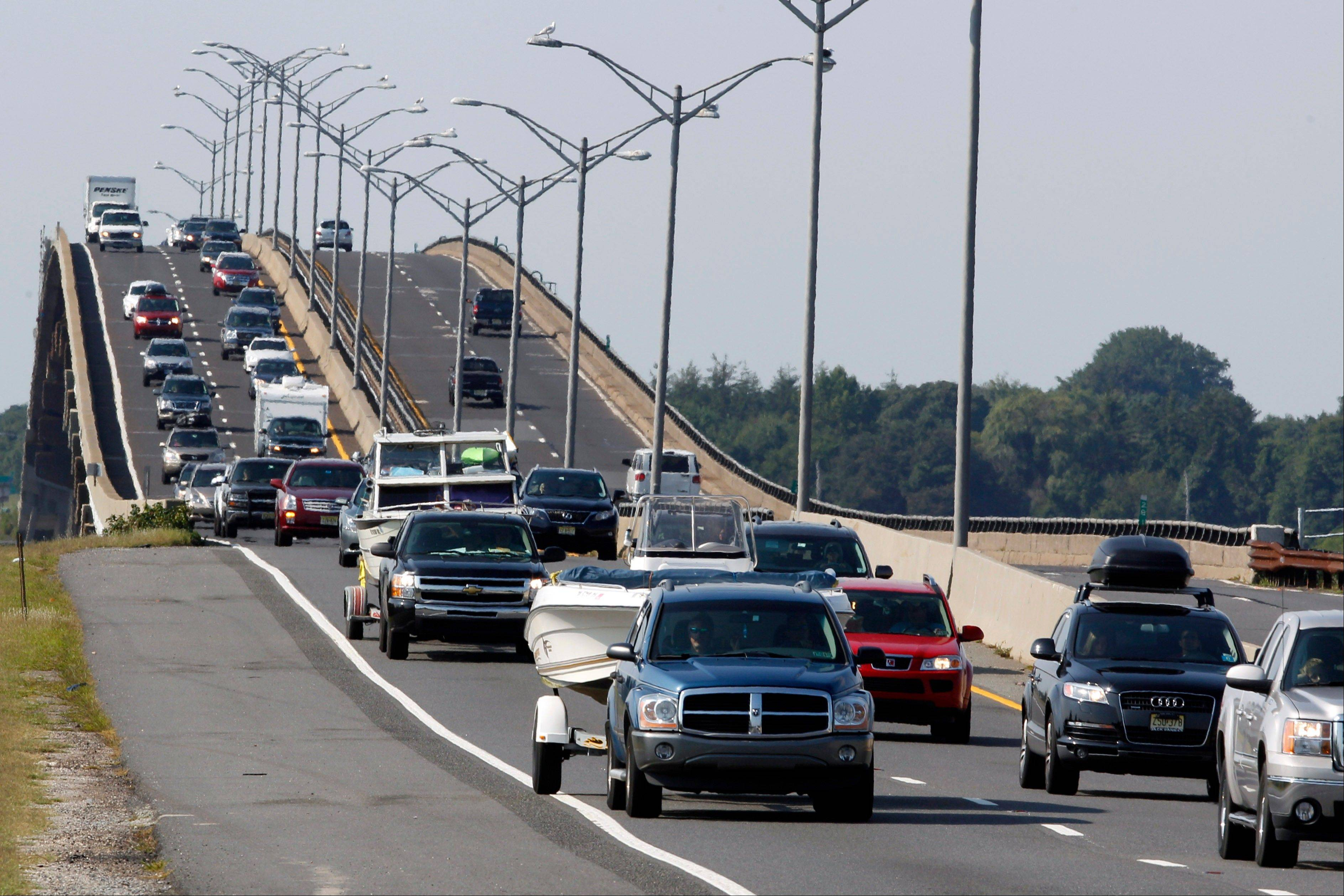 Sport utility vehicles pulling pleasure boats drive in lines of traffic headed north on the Garden State Parkway across the Great Egg Harbor Bay Inlet Bridge, Friday near Ocean City, N.J., as much of the Jersey shore evacuates inland ahead of Hurricane Irene.