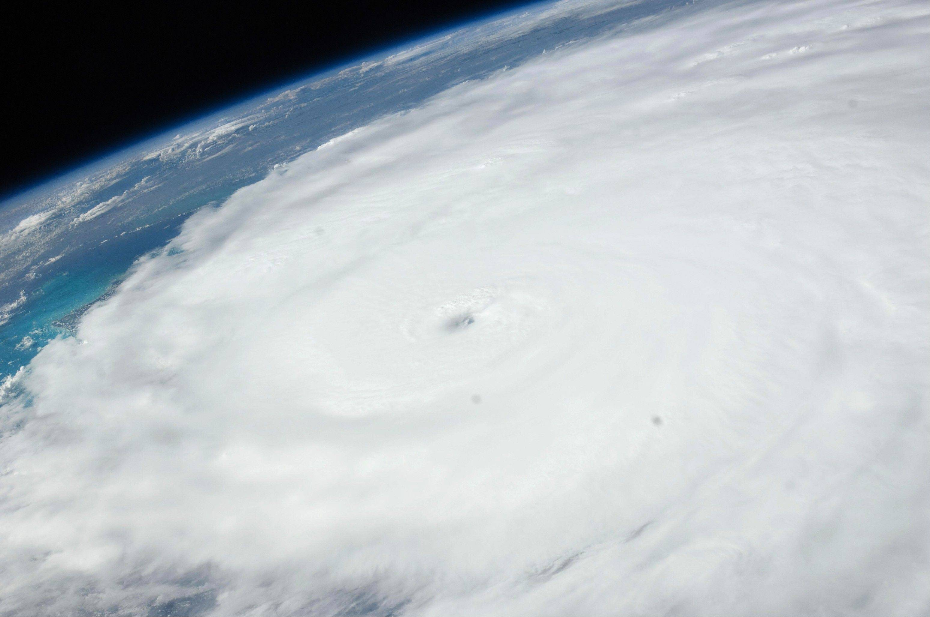 An image provided by NASA shows Hurricane Irene as photographed from onboard the International Space Station. The image, captured with a 38 mm lens, reveals the eye of the storm at center of the frame.