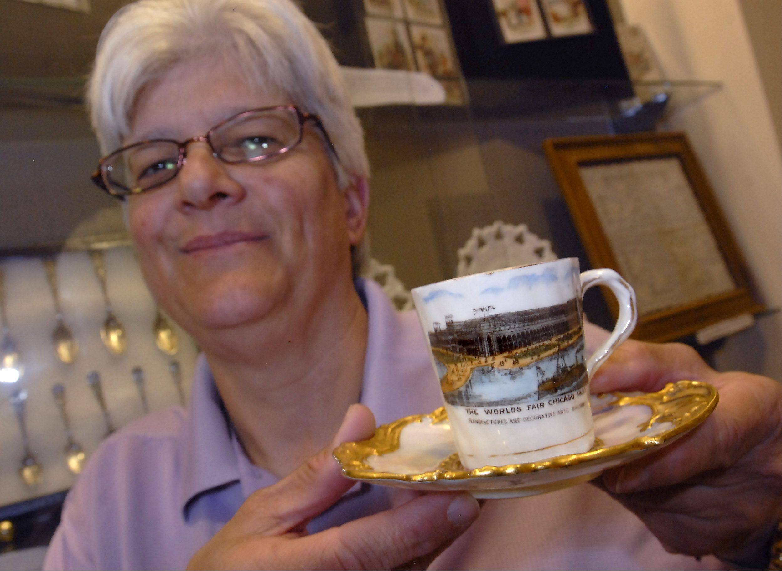 This demitasse cup from Coalport, England was hand painted for the Exposition. Debbie Smart is displaying pieces from her collection at the Arlington Heights village hall.