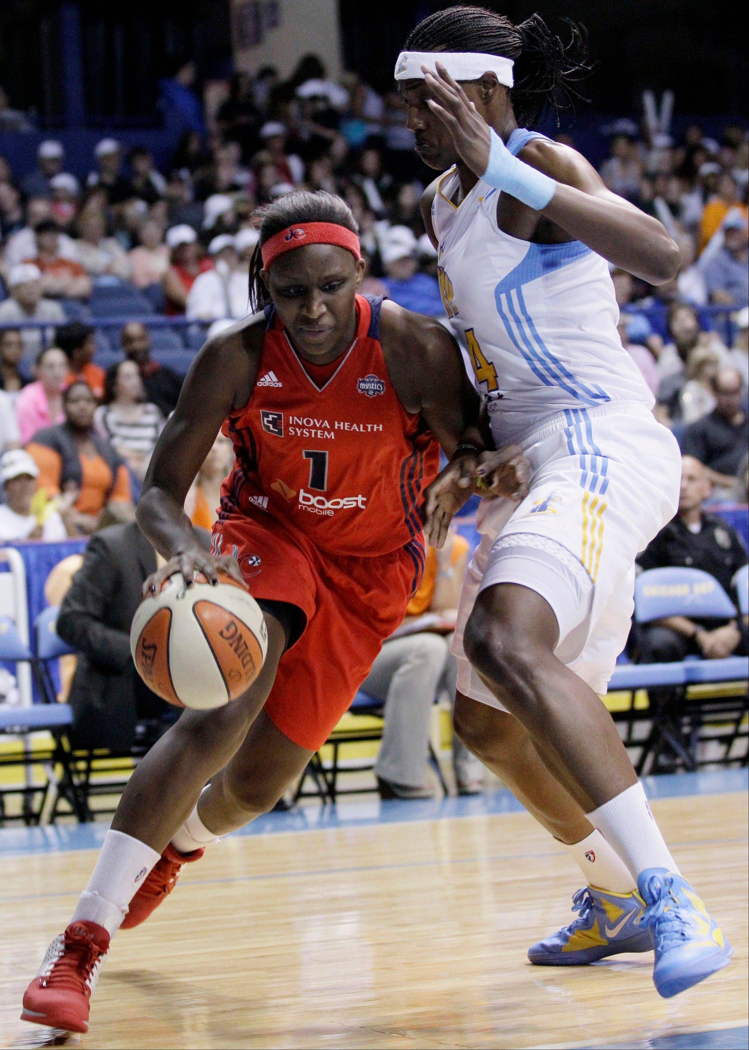 The Mystics' Crystal Langhorne drives to the basket Friday as the Sky's Sylvia Fowles plays defense.