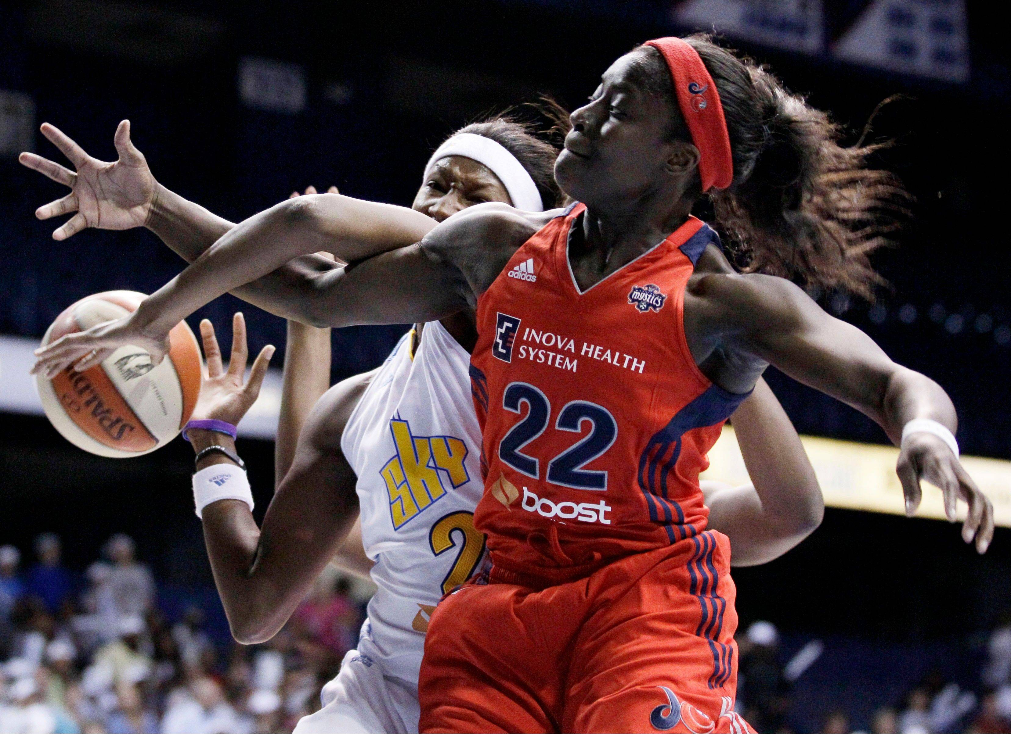 The Mystics' Matee Ajavon and the Sky's Michelle Snow battle for a rebound Friday.
