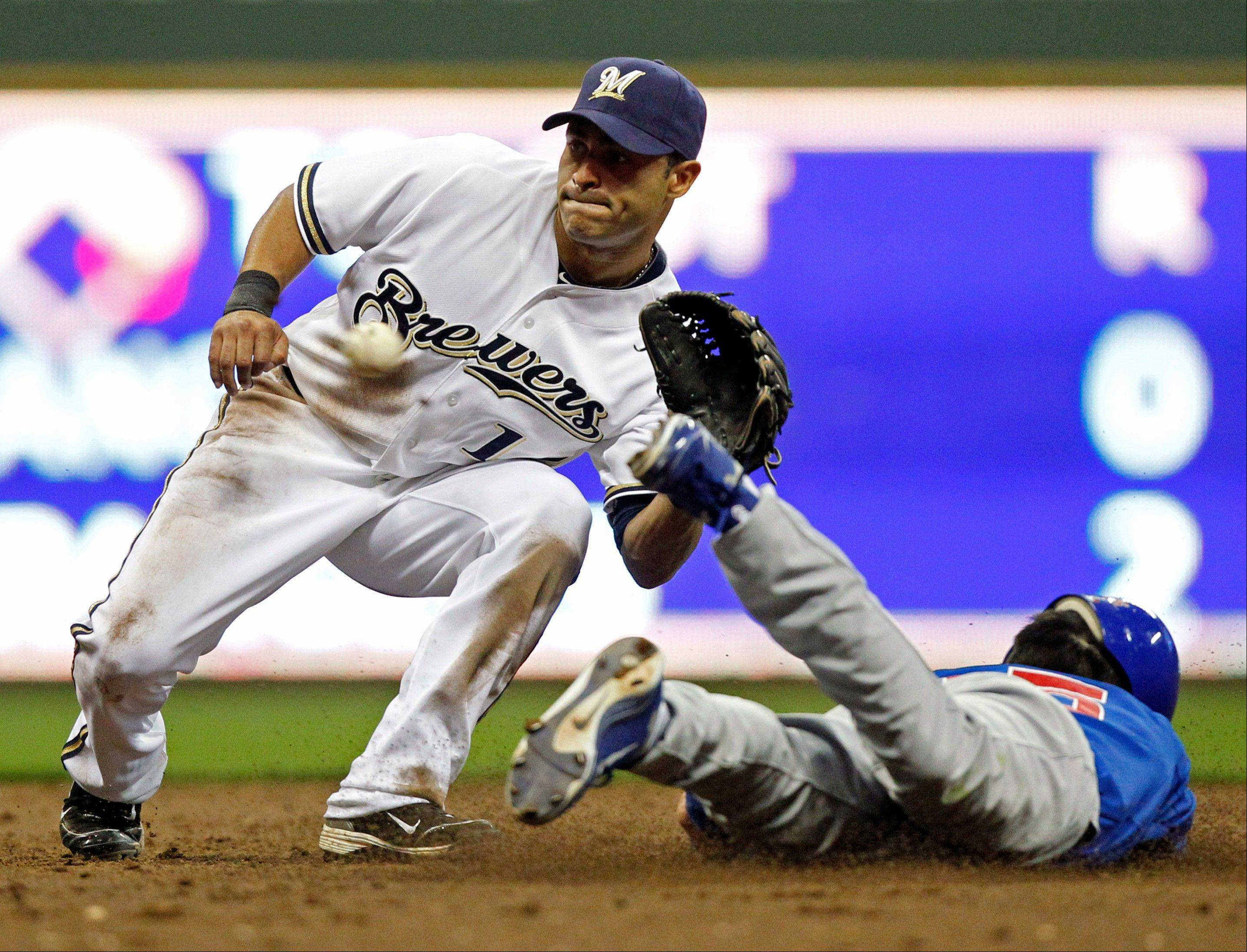 Darwin Barney, right, steals second ahead of the tag by Milwaukee Brewers' Jerry Hairston Jr., in the third inning of a baseball game on Friday, Aug. 26, 2011, in Milwaukee.