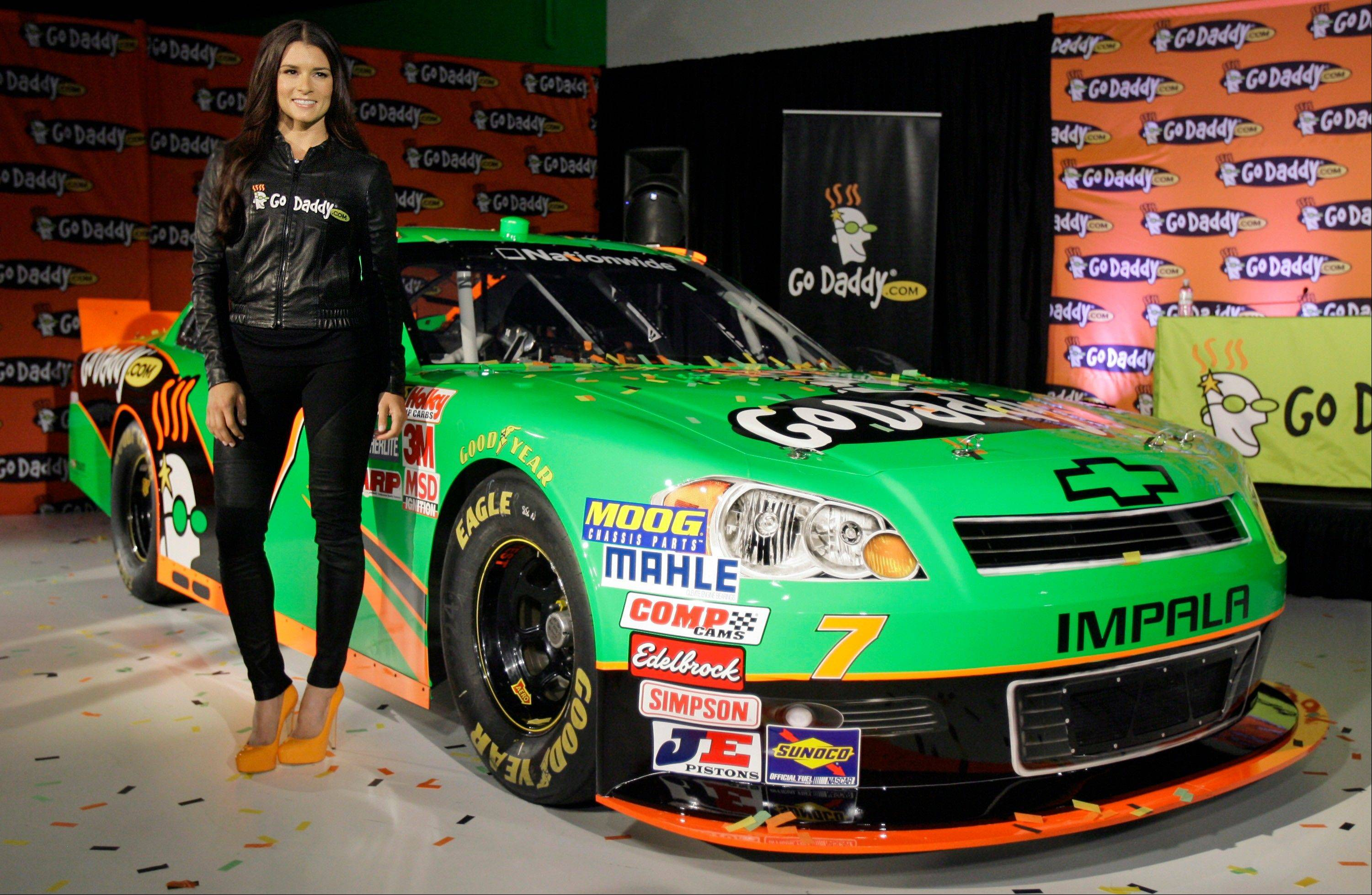 Driver Danica Patrick displays Thursday the car that she will drive full-time in the NASCAR Nationwide Series circuit and select Sprint Cup races. After months of skirting speculation, Patrick announced Thursday that she's leaving IndyCar in 2012 to run a full Nationwide schedule with JR Motorsports and up to 10 Sprint Cup races for Stewart-Haas Racing.