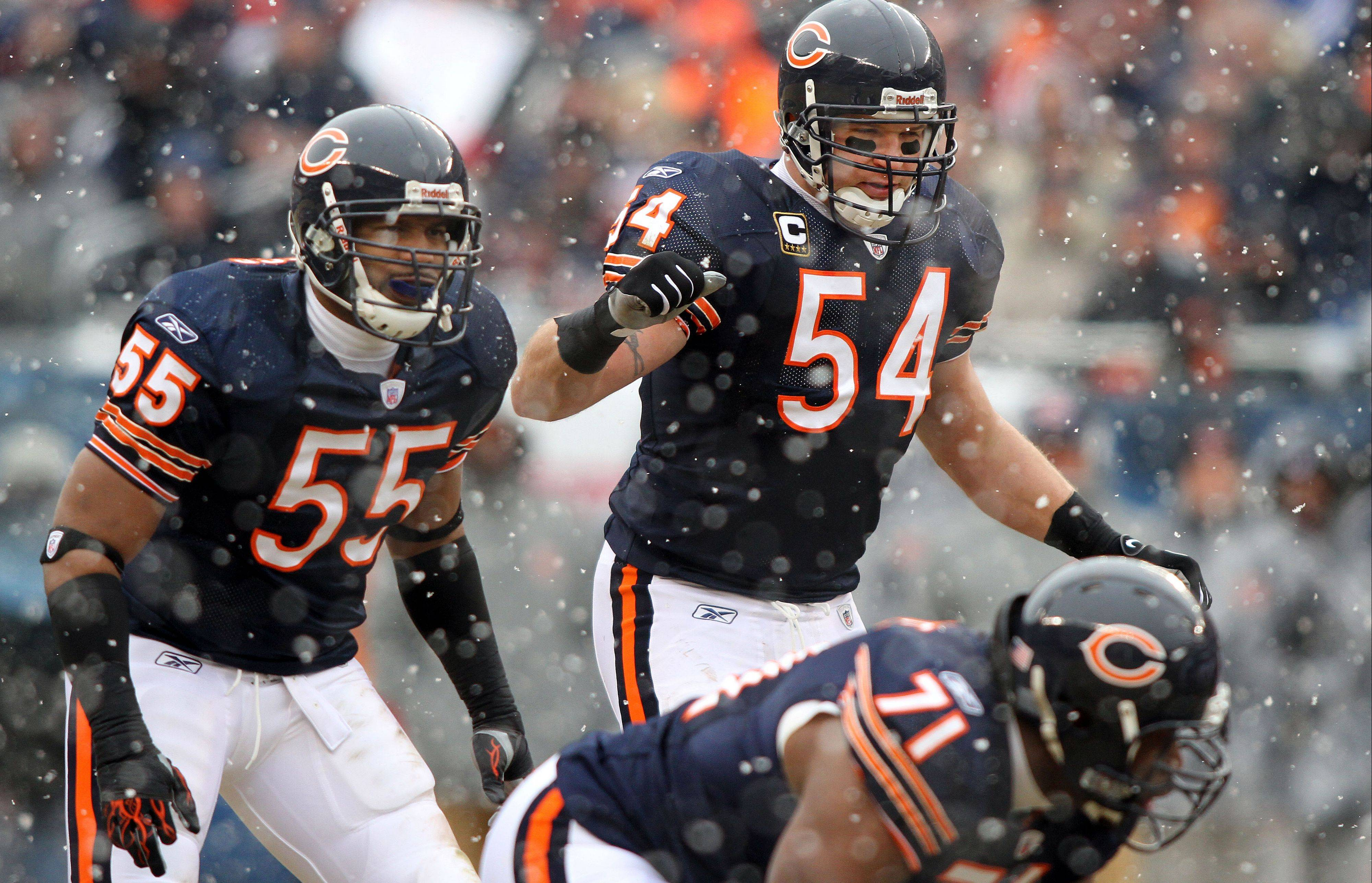 How many more good years will the veterans on the Bears' defense have together? Linebacker Lance Briggs, left, and defensive end Israel Idonije (71) turn 31 in November. Linebacker Brian Urlacher, middle, is 33.