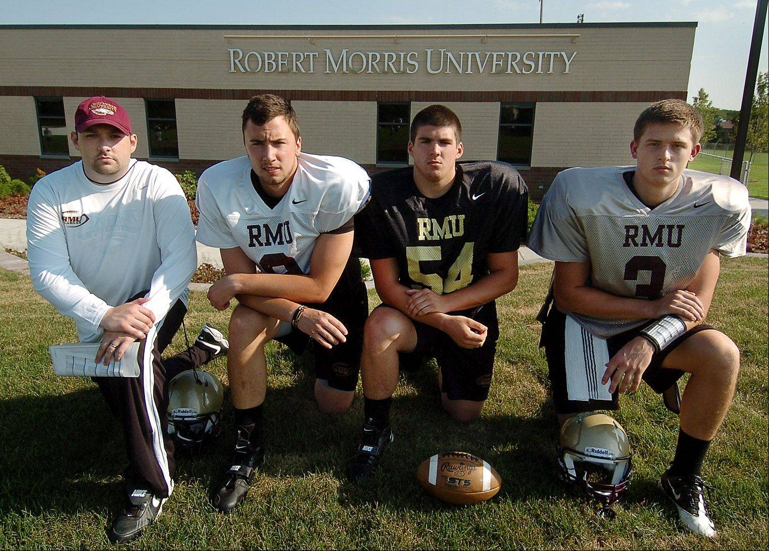 Robert Morris University's inaugural season of football includes, from left, head coach Jared Williamson, tight end Tyler Warden (Glenbard West), linebacker Jason Olson (Hersey) and quarterback Matt Westerkamp (Montini).
