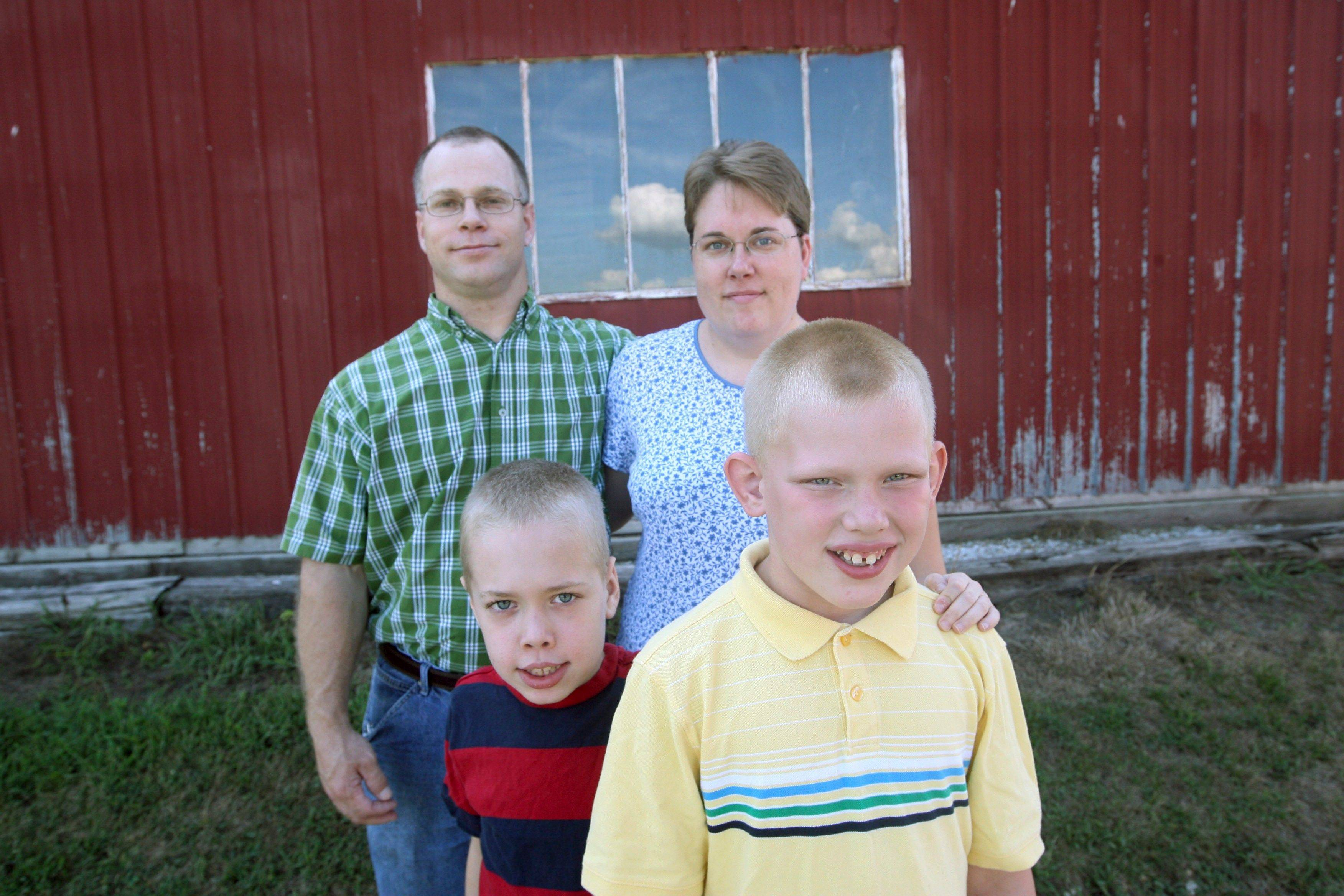 Tony and Jesica Huber pose with their sons Ethan, 8, left, and Andrew, 11, at their home near Plainville, Ill. Andrew, was diagnosed with Fragile X Syndrome, which after years of research is now considered the leading cause of inherited mental impairment and the leading known cause of autism.
