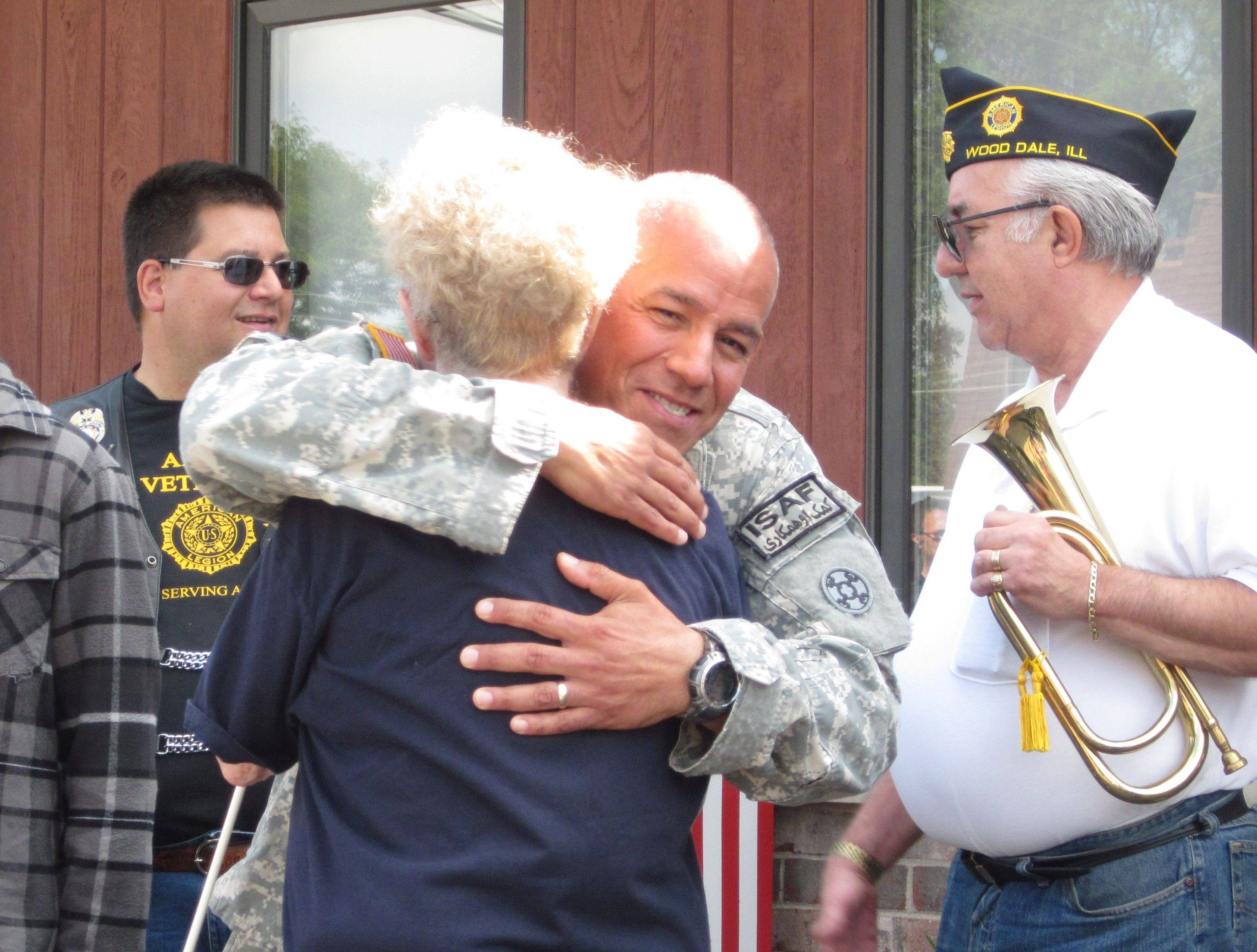 Sgt. Carlos Velazquez of Wood Dale hugs Dolores Zamminer of Chicago during a welcome home ceremony held Saturday in Wood Dale to honor Velazquez's return from service in the Army National Guard.
