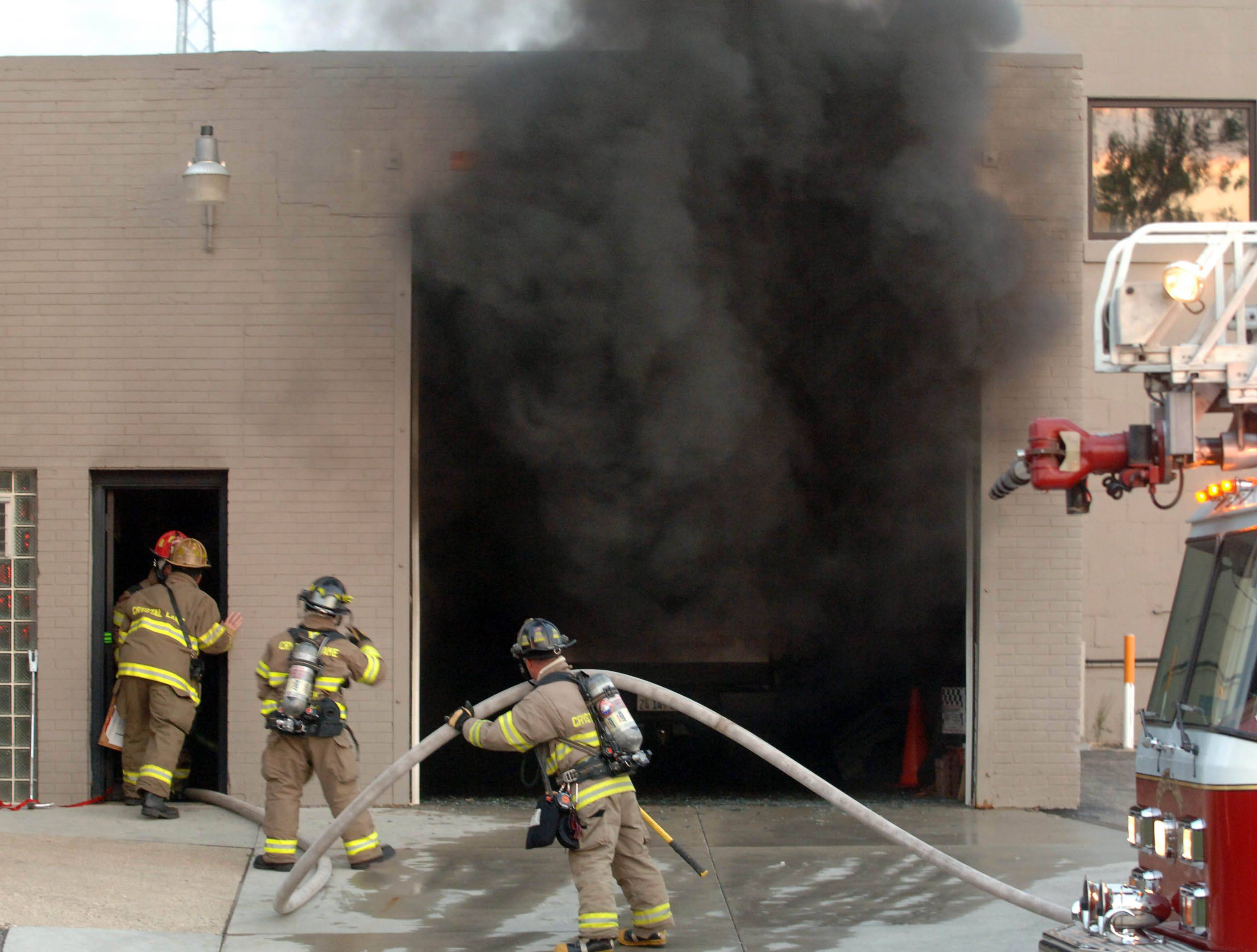 A blaze that Crystal Lake firefighters extinguished on Friday night at a downtown auto body shop started in a car inside the building, officials said Saturday.