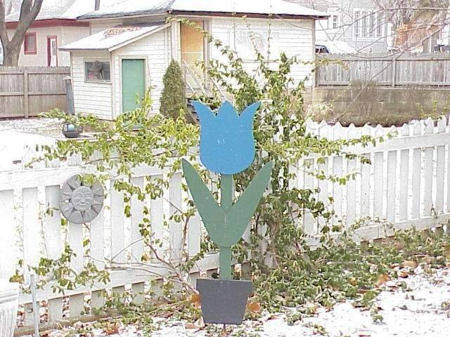 "This week someone stole the sign that goes in front of homes that host Blue Tulip parties in the North East Neighborhood. The sign symbolizes a 15-year tradition and residents are asking for the sign's safe return. ""It's really ugly and tacky but it means a lot to the neighborhood,"" resident Betsy Couture said."