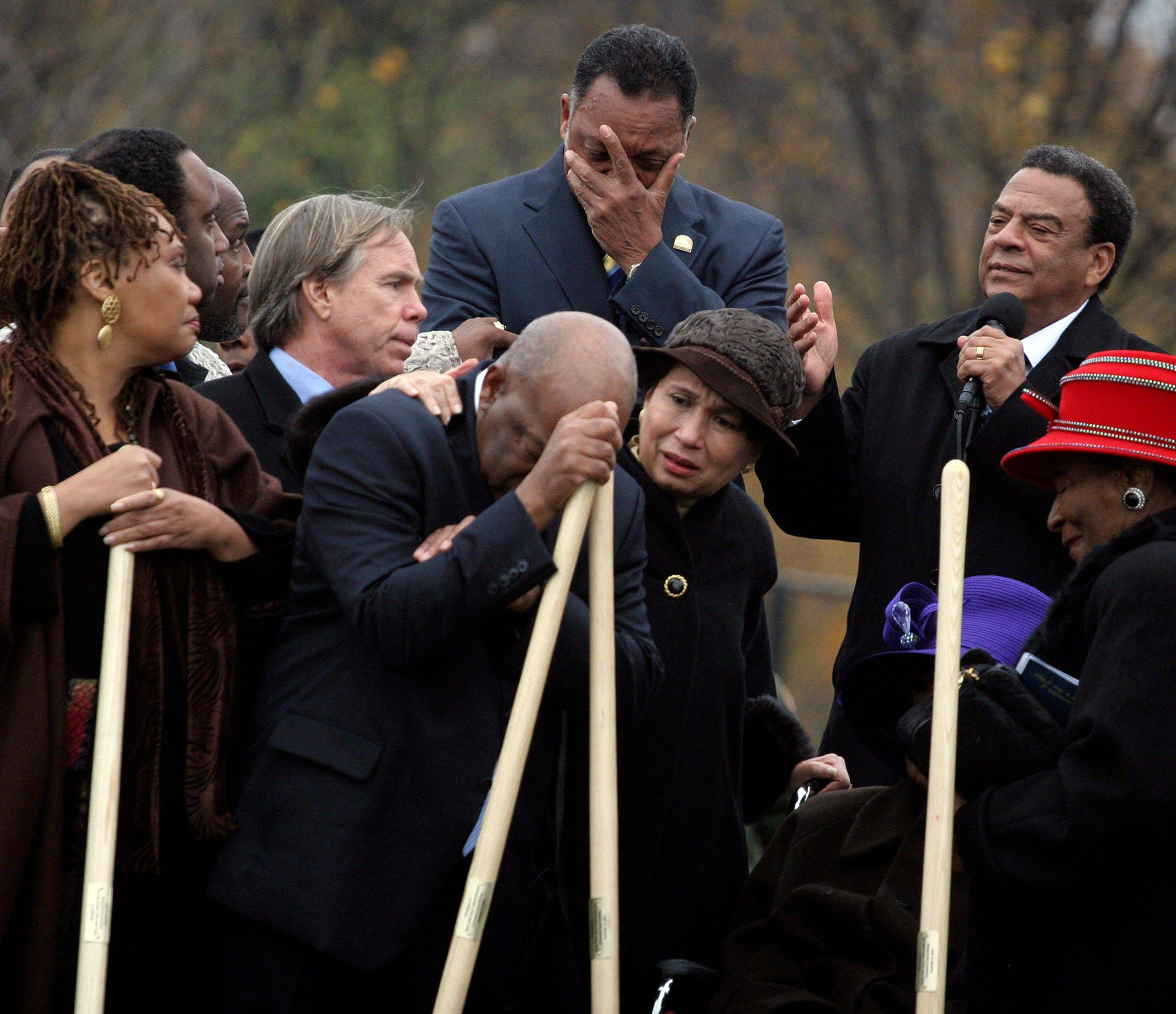 The Rev. Jesse Jackson, top center, and Congressman John Lewis, leaning on shovel, becoming emotional as Ambassador Andrew Young, top right, speaks about the significance of the late Martin Luther King Jr. during the groundbreaking for King's memorial on the National Mall in Washington in 2006