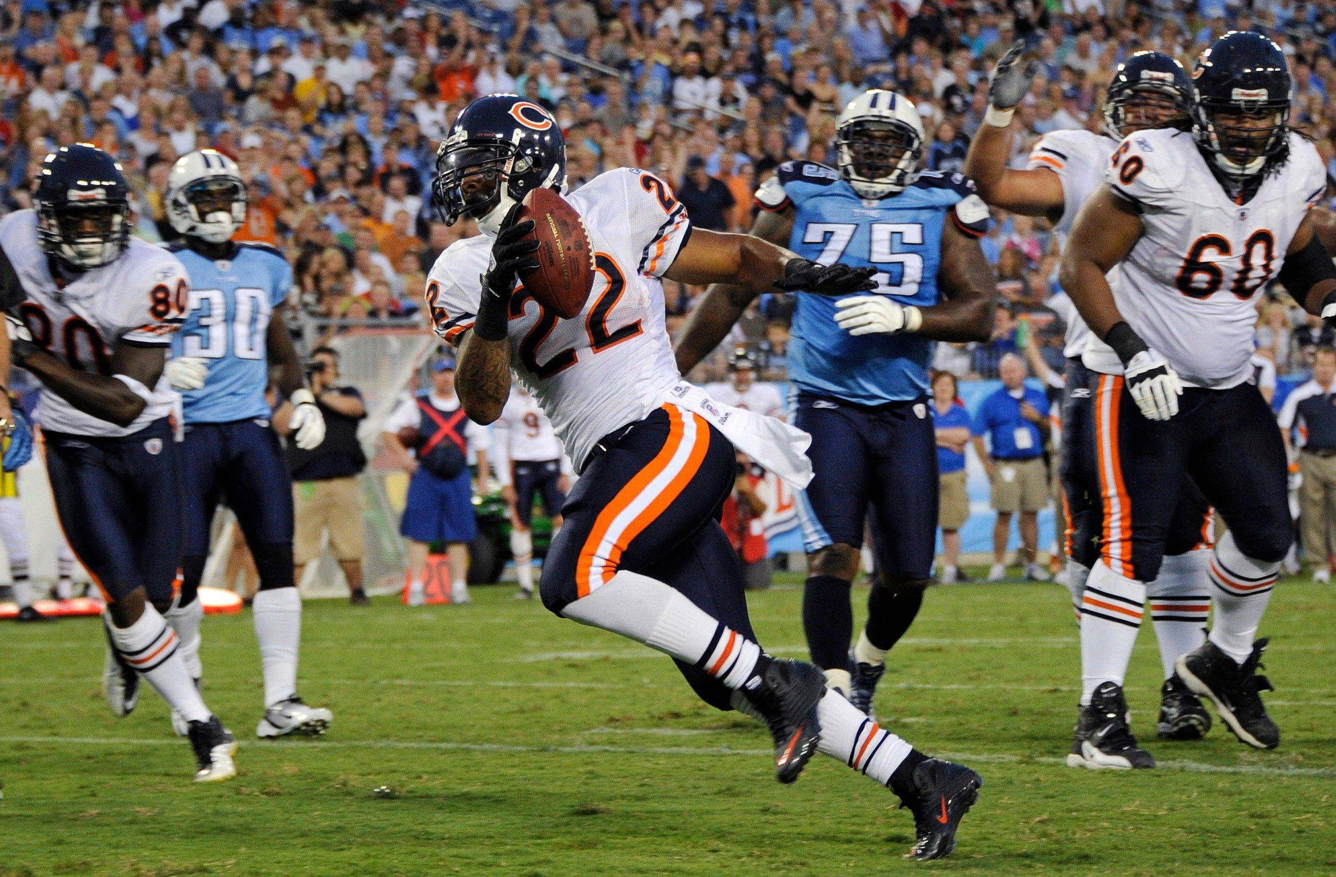 Chicago Bears running back Matt Forte (22) scores a touchdown on a 3-yard run against the Tennessee Titans in the first quarter of an NFL football preseason game Saturday, Aug. 27, 2011, in Nashville, Tenn.