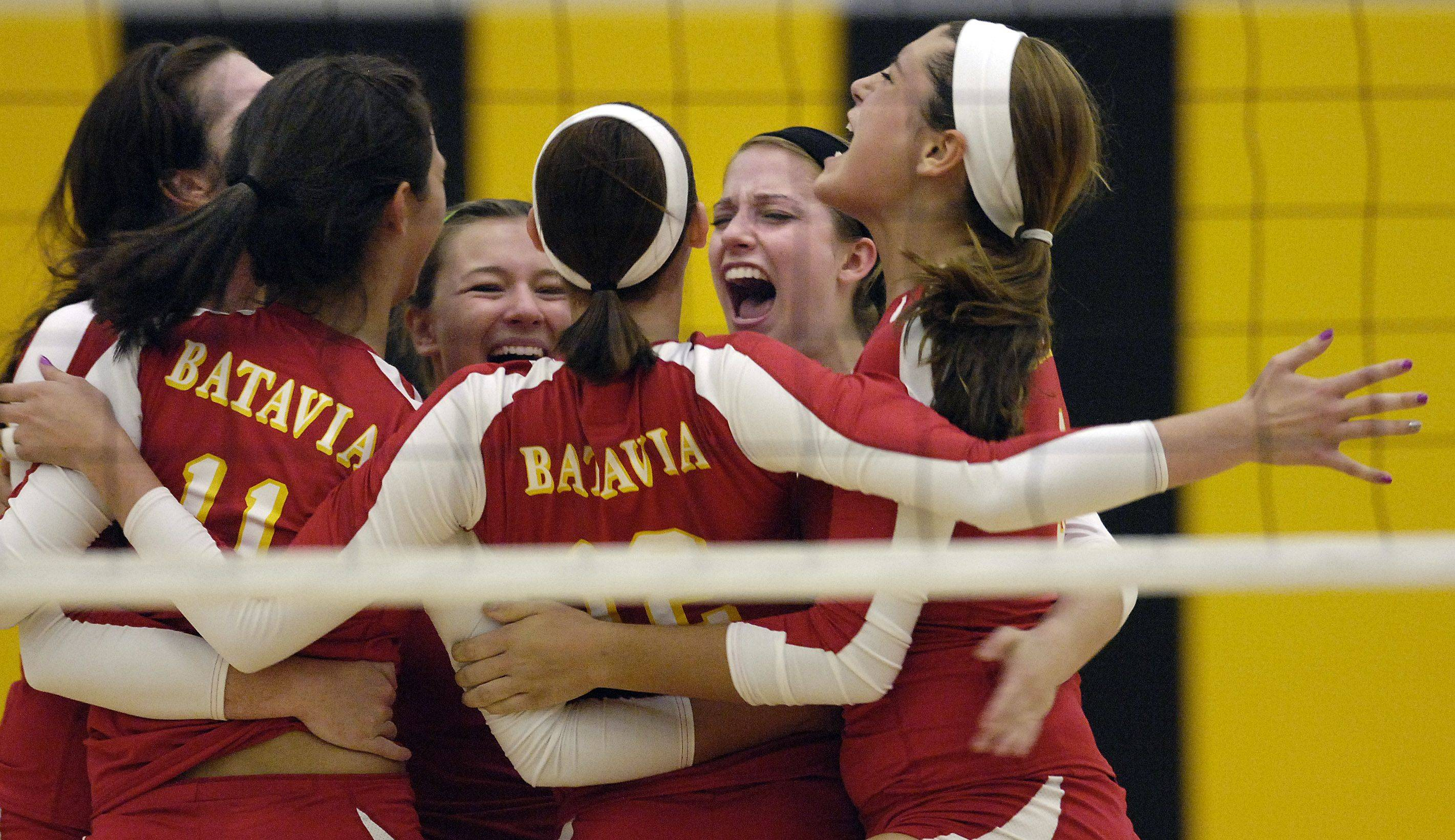 Batavia celebrates it's 2-game victory over Metea Valley Thursday.