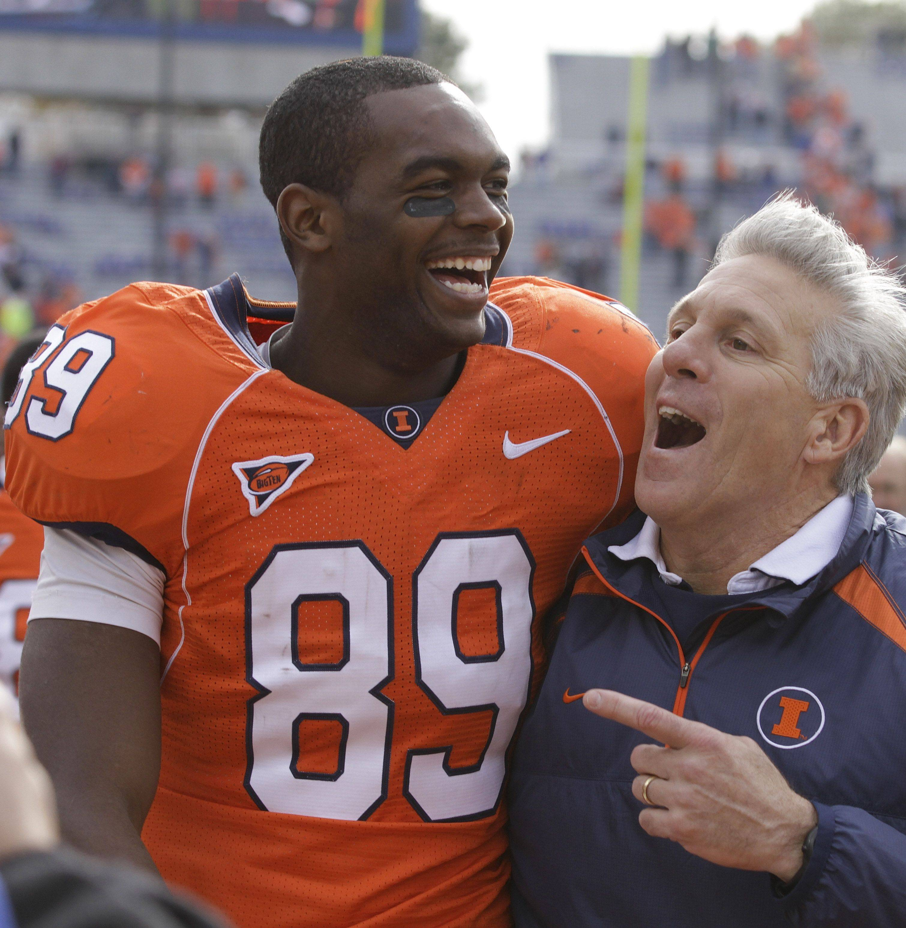 Coach Ron Zook celebrates with tight end Evan Wilson after Illinois beat Purdue 44-10 last season. Wilson is back this fall.