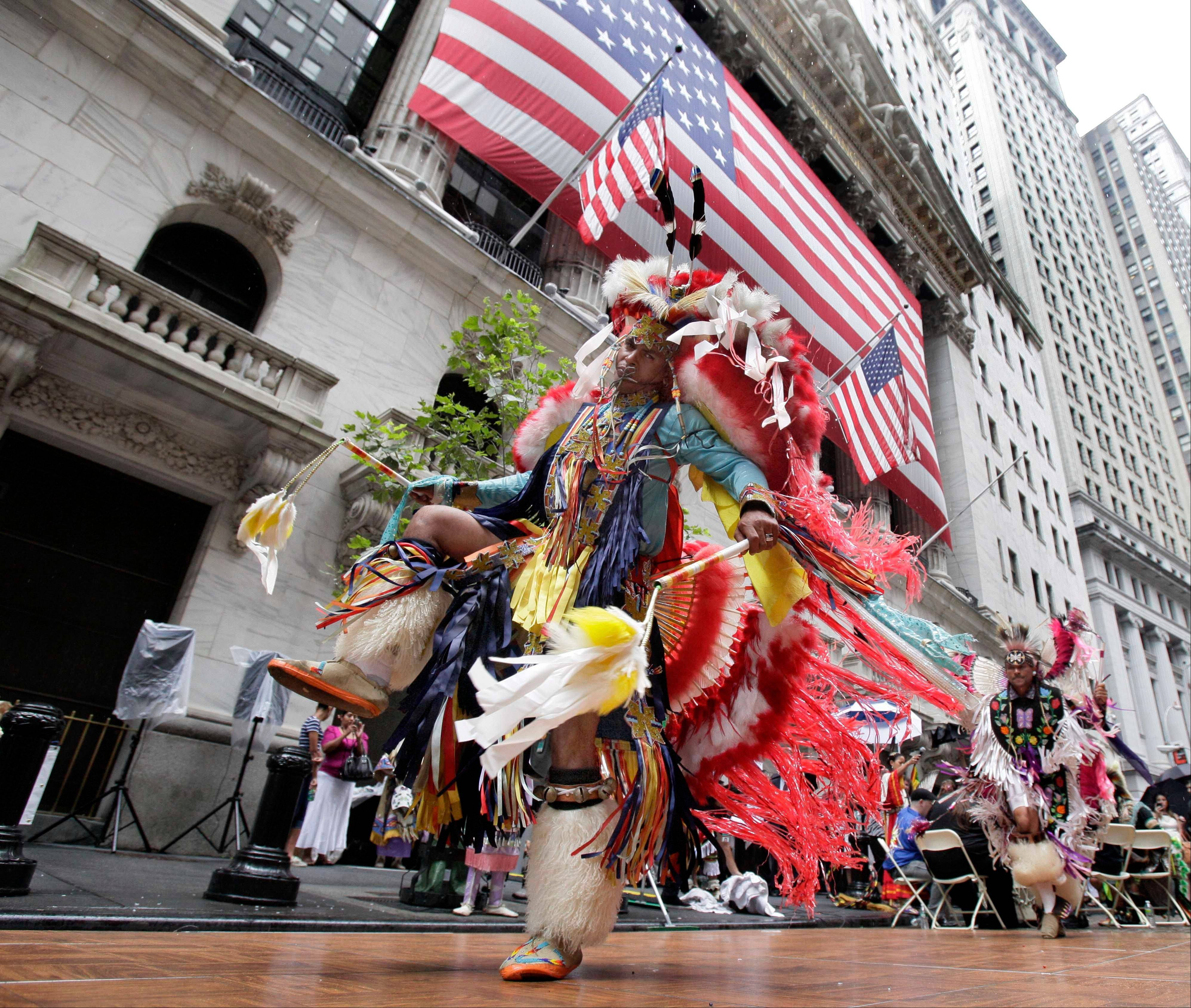 Waya Richardson, of the Tuscarora tribe, dances outside the New York Stock Exchange Thursday during the ceremonies celebrating NativeOne becoming the exchange's first Native American-owned member. Stocks seem to have stabilized last week.
