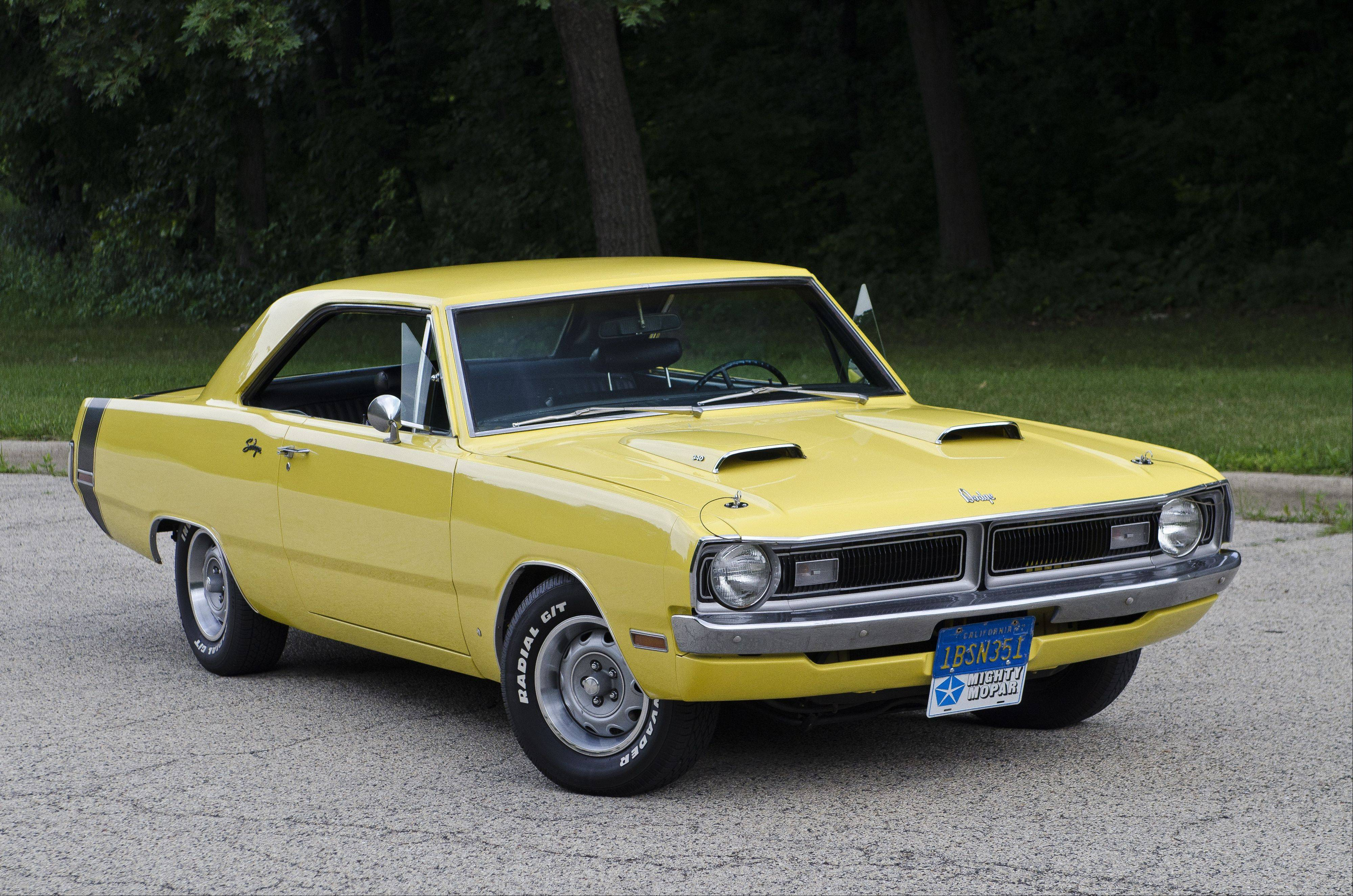 A bumblebee stripe around the trunk lid and twin hood scoops are telling signs that this is no ordinary Dodge Dart.