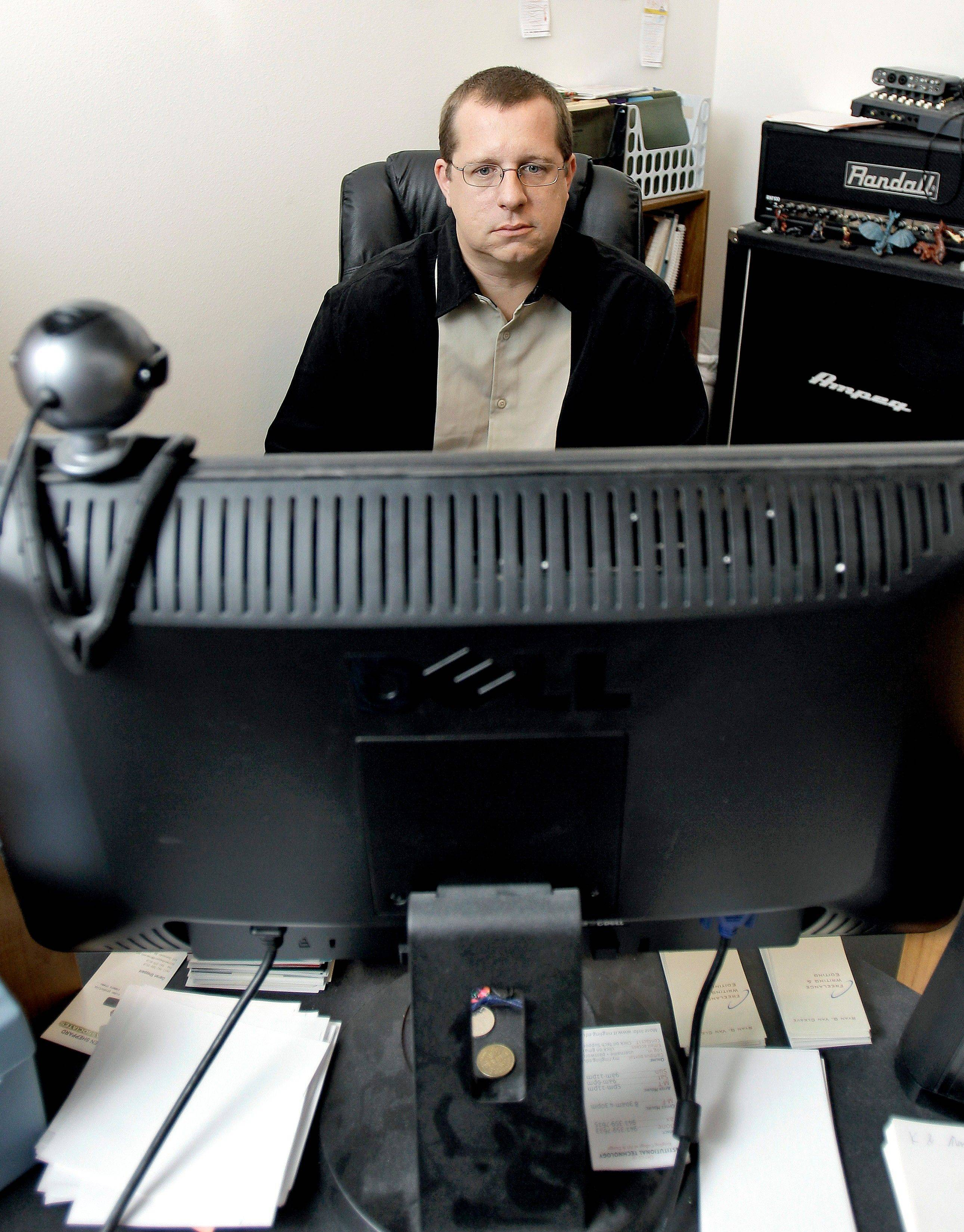 Ryan Van Cleave sits behind a computer at his home in Sarasota, Fla. Gaming and thinking about video games was all-consuming for Van Cleave. Yet living inside the game World of Warcraft, which became his obsession, seemed preferable to the drudgery of everyday life.