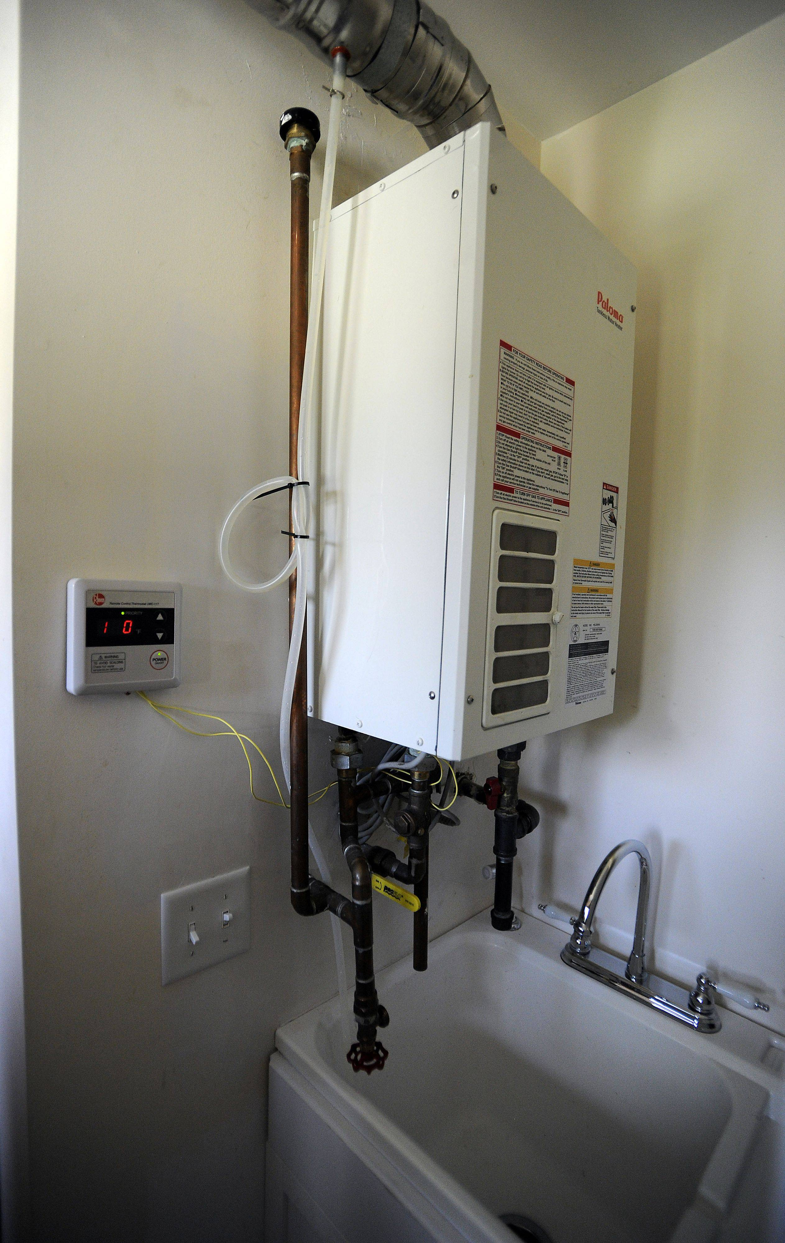 Mark Welsh/mwelsh@dailyherald.comThe home of Charles Daniels in Schaumburg was remodeled taking eight months with energy saving methods such as his tankless water heater.