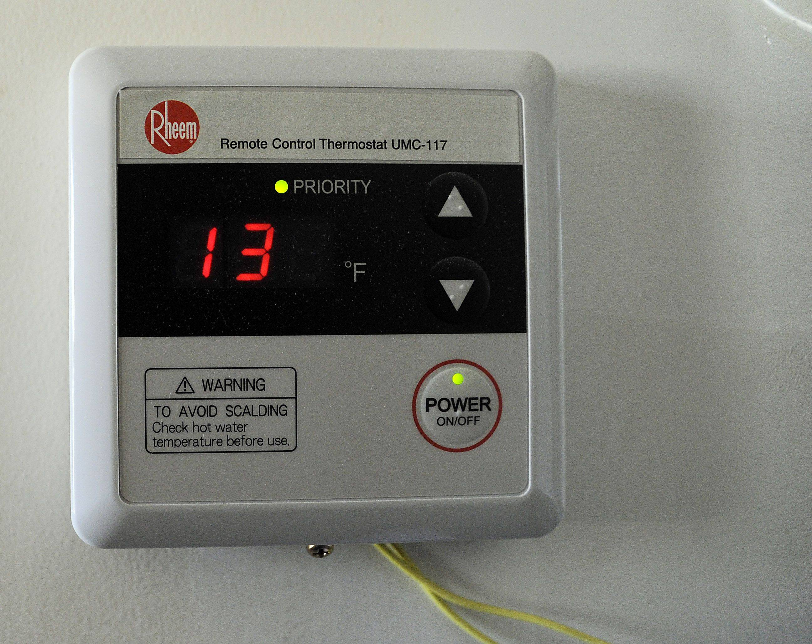Mark Welsh/mwelsh@dailyherald.comThe home of Charles Daniels in Schaumburg was remodeled taking eight months with energy saving methods such as this remote control thermostat which contols his tankless water heater for hot water.